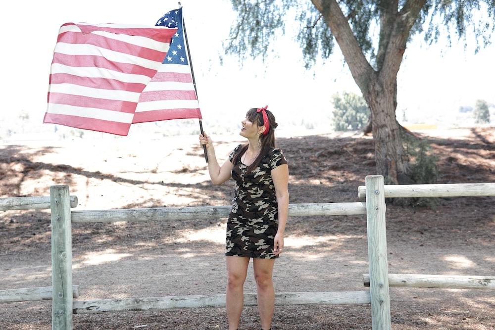 woman holding U.S. flag