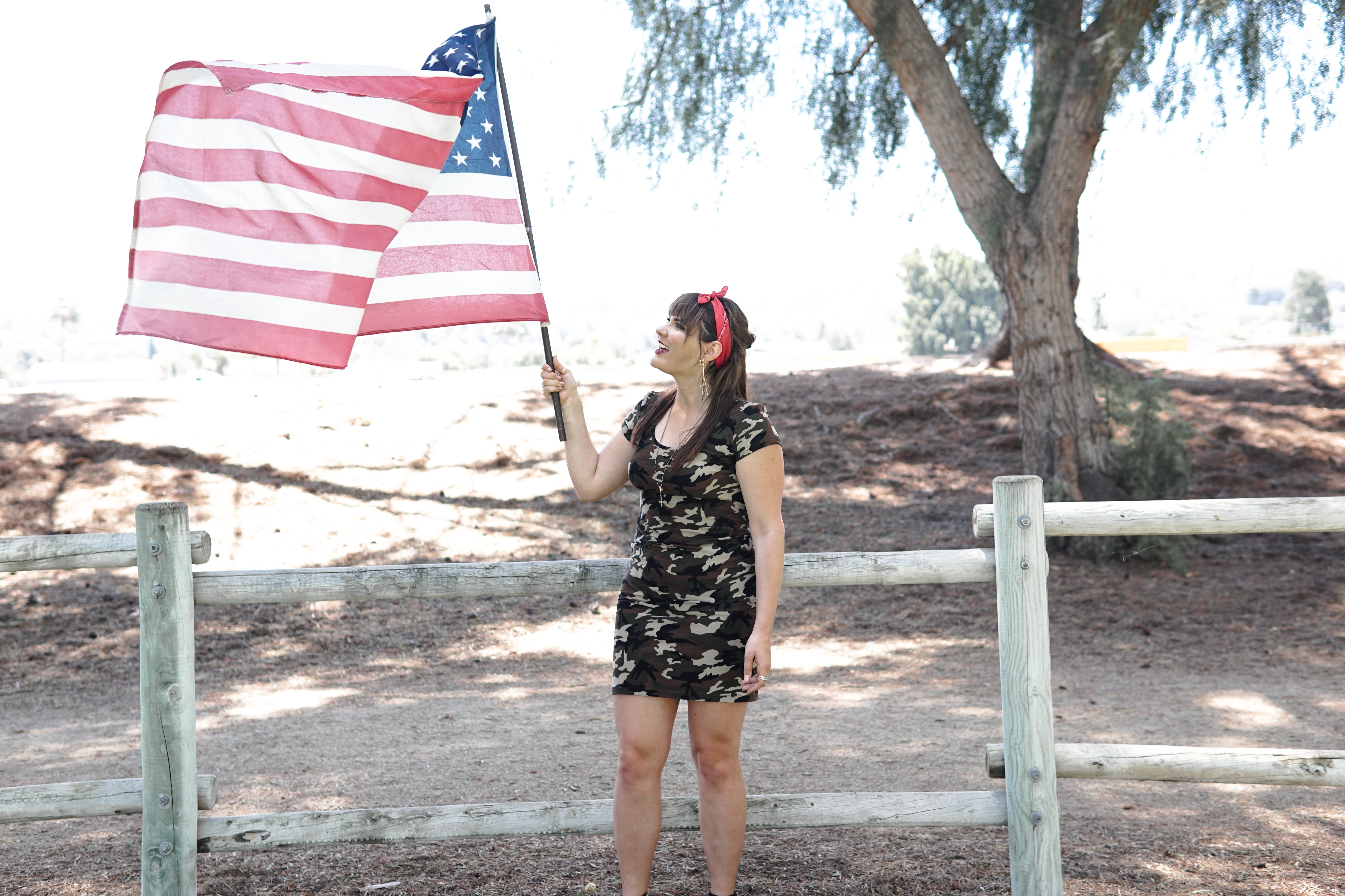 woman holding U.S. flag