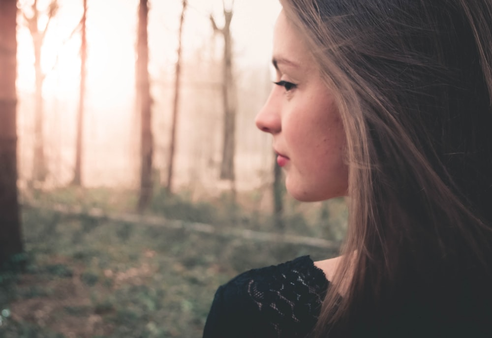 selective focus photography of woman's side view face
