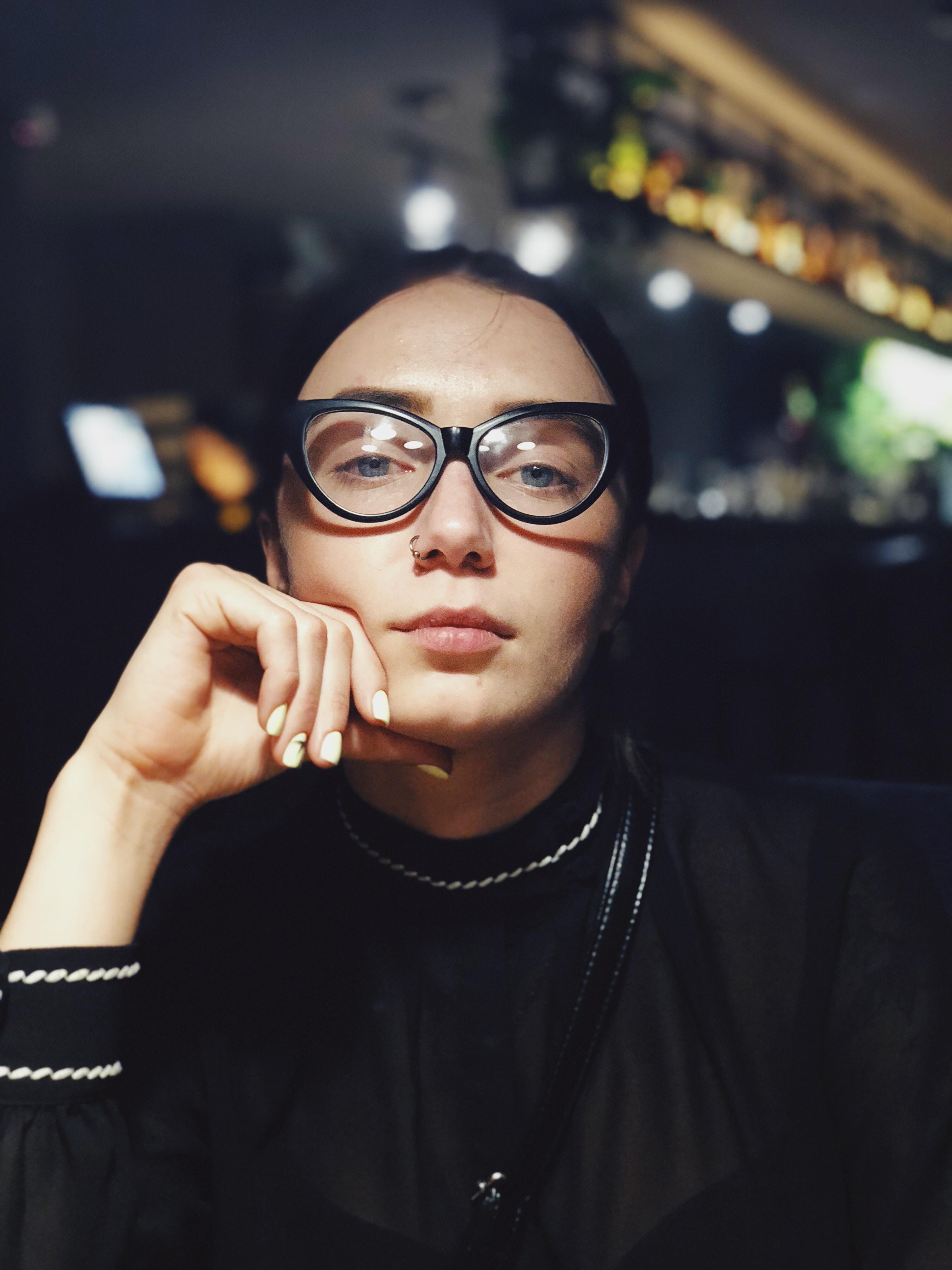 selective focus photography of woman wearing black eyeglasses