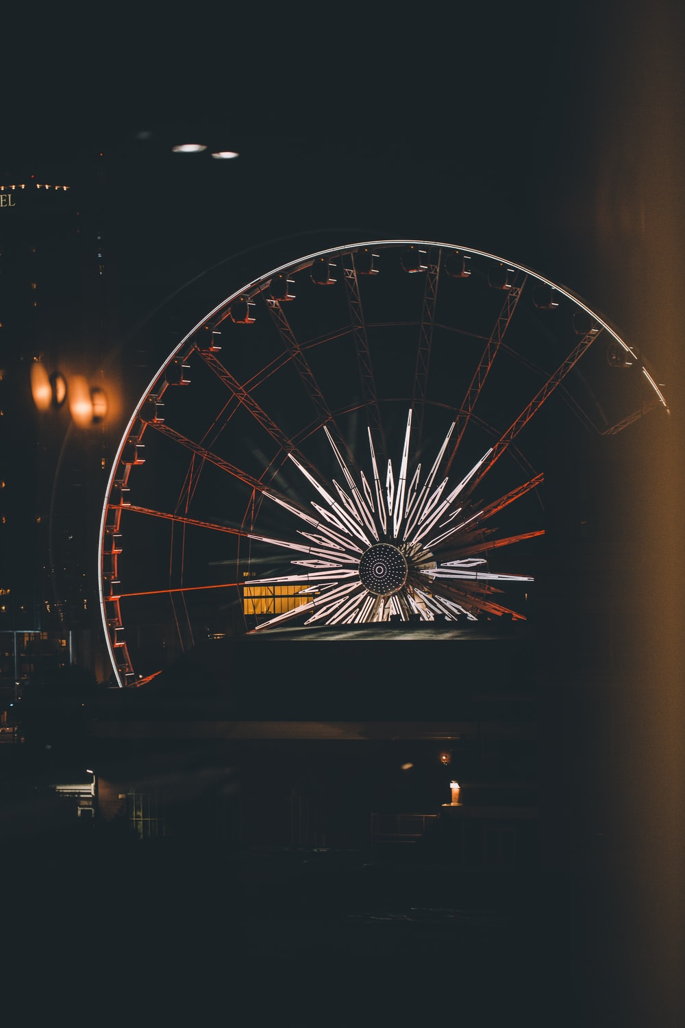 gray and black lighted Ferris wheel during nighttime