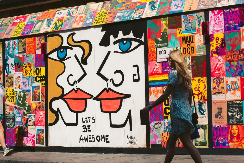 woman walking passes graffiti
