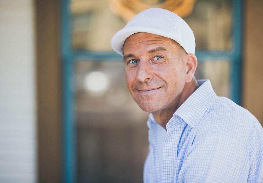 man smiling while sitting