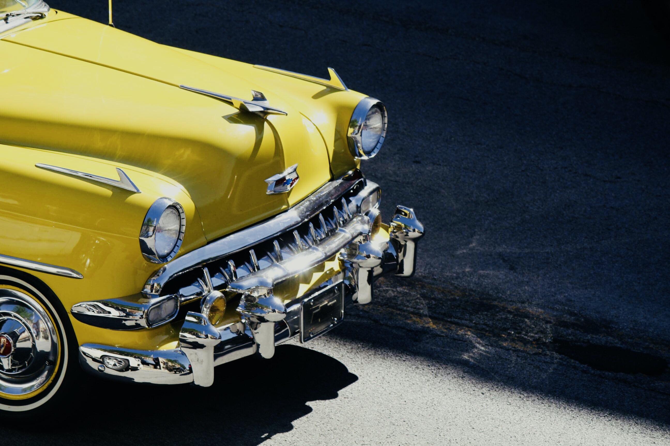 photo of yellow Cadillac car
