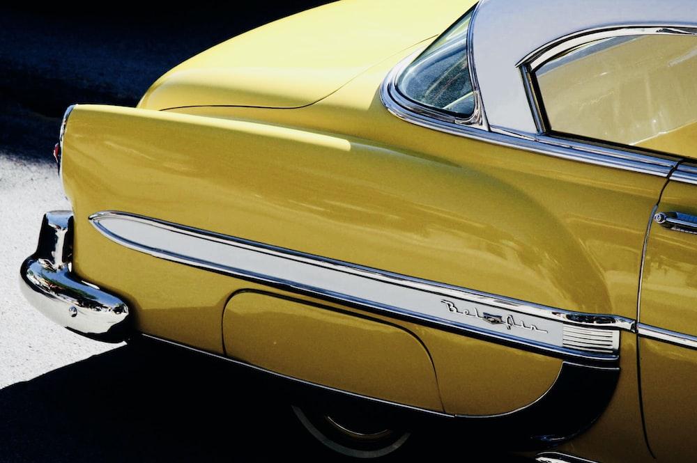 vintage yellow car under sunny sky