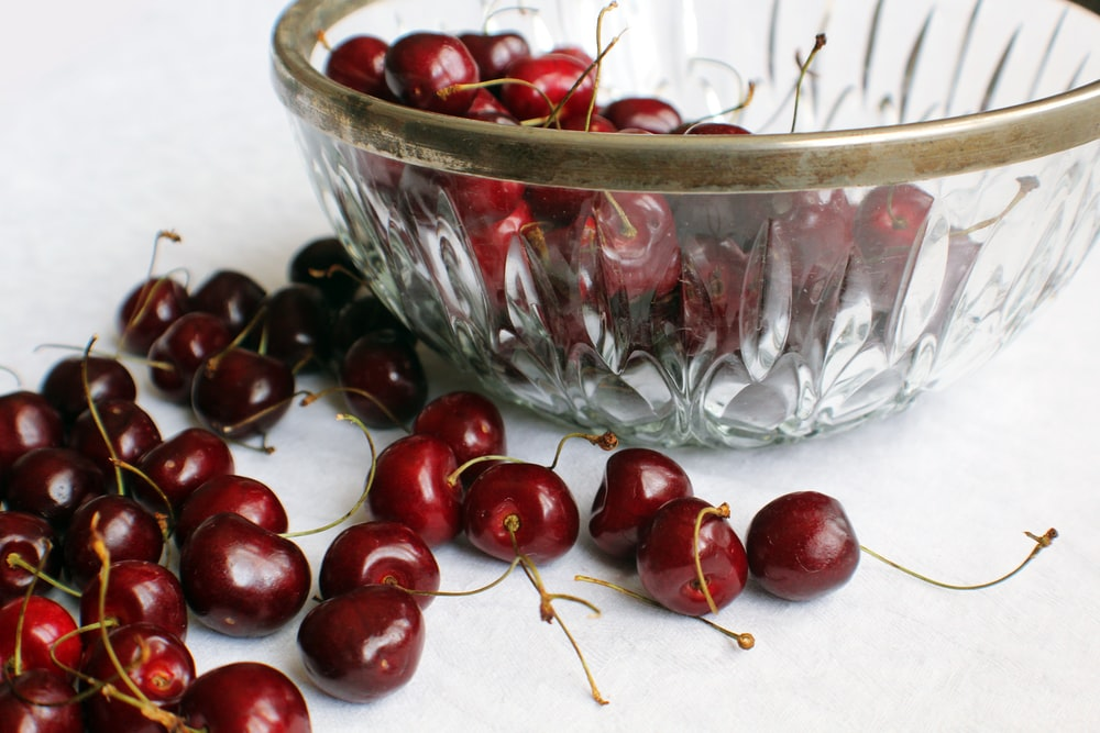 bunch of red cherry fruits
