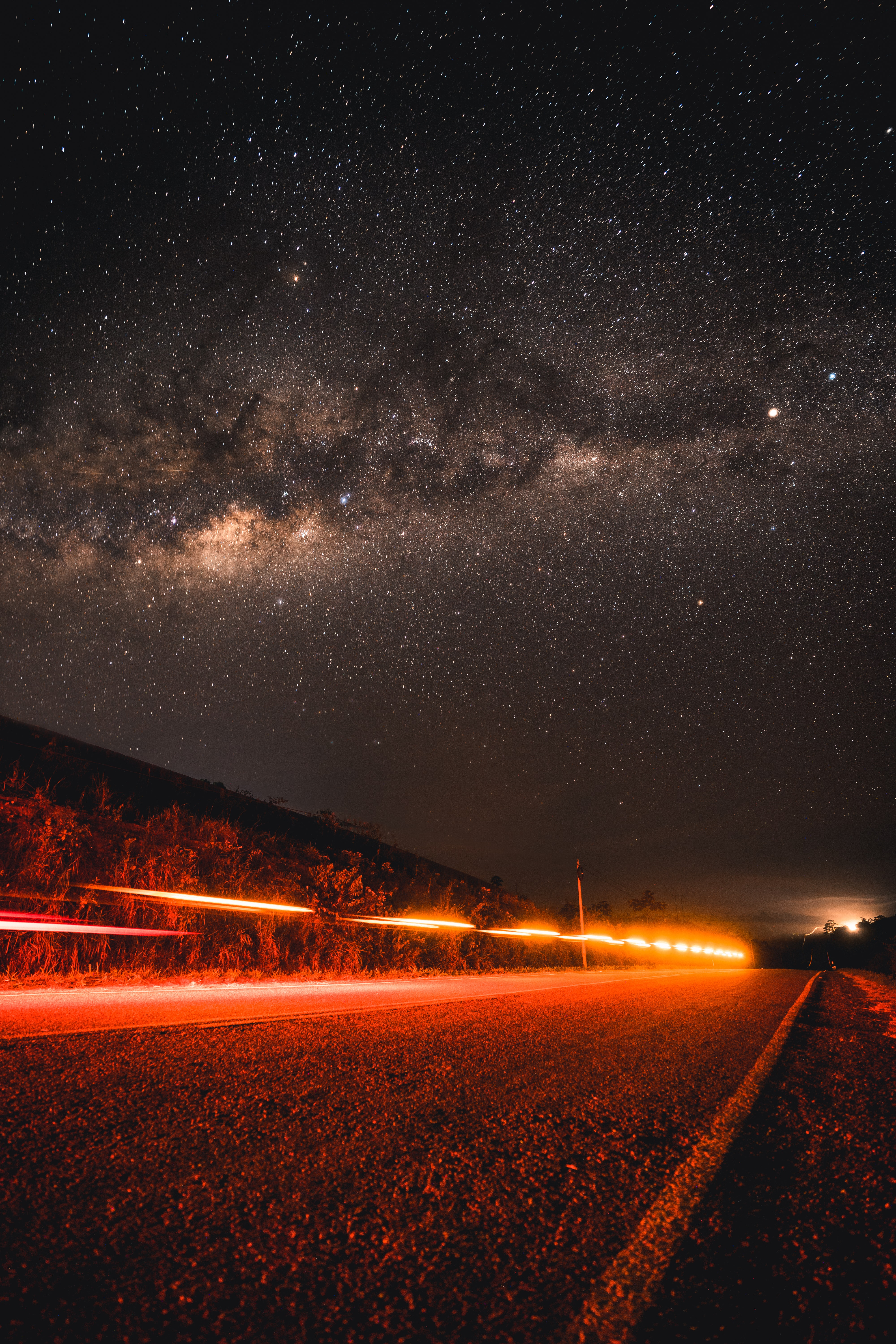 time lapse photography of stars and asphalt road
