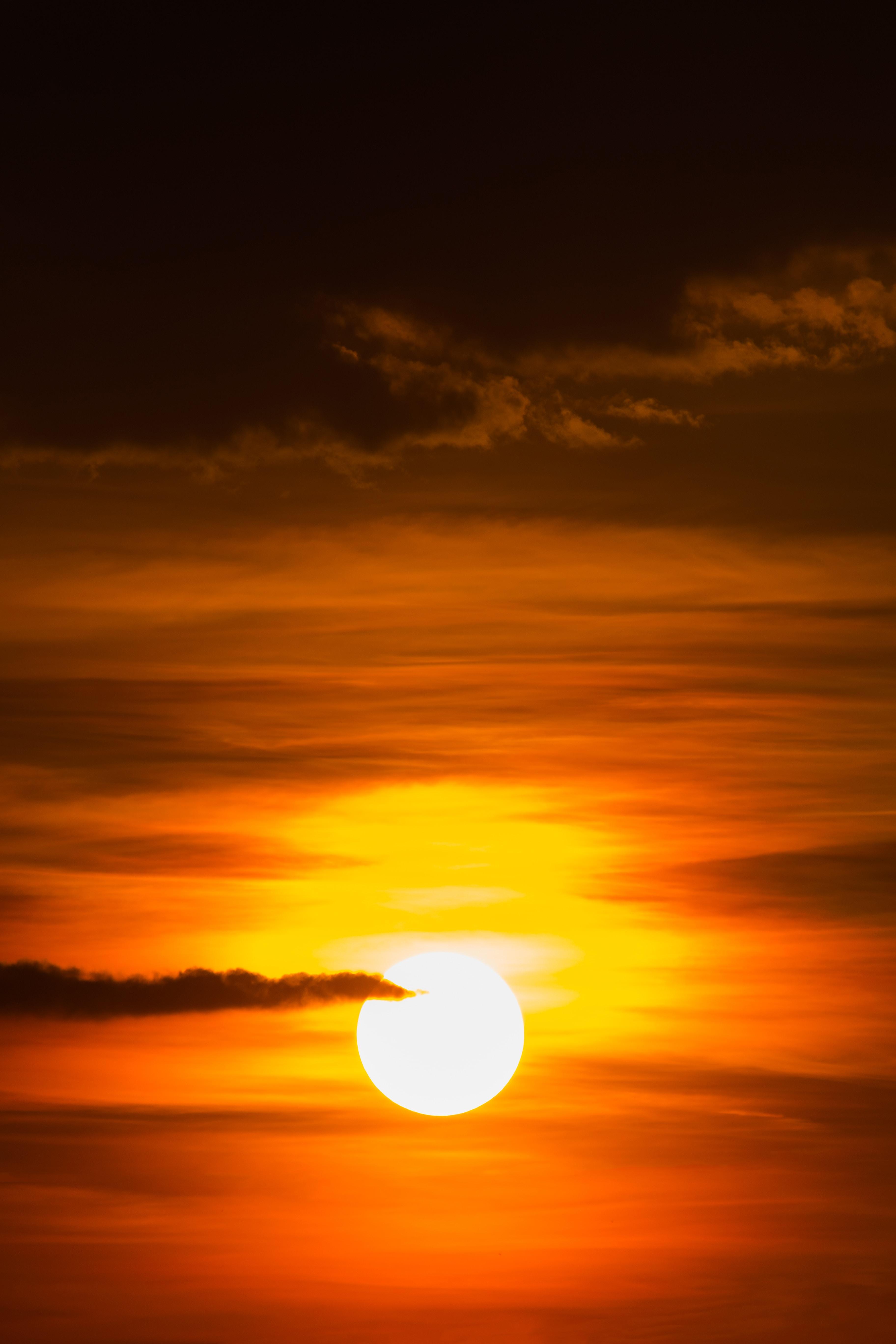 sunset under grey clouds