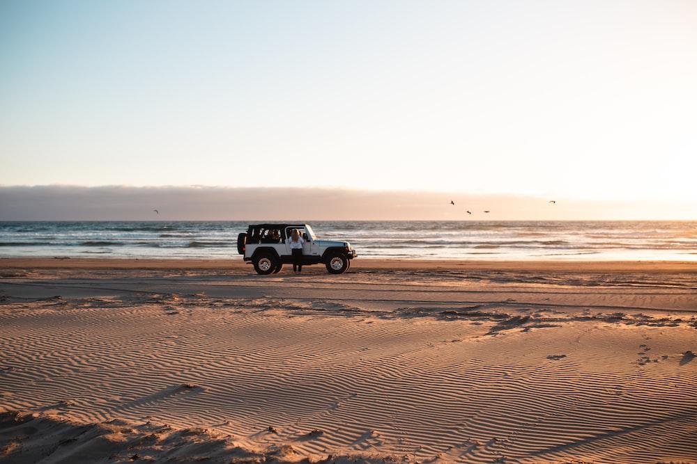 white wrangler beside the beach