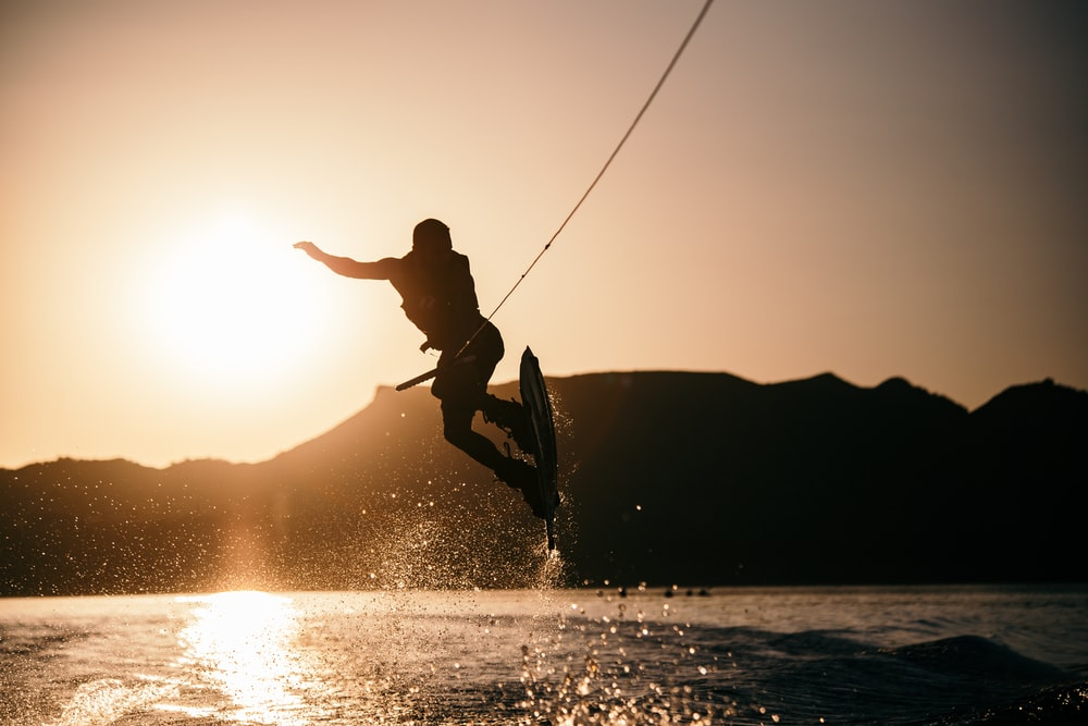 person wake boarding on body of water