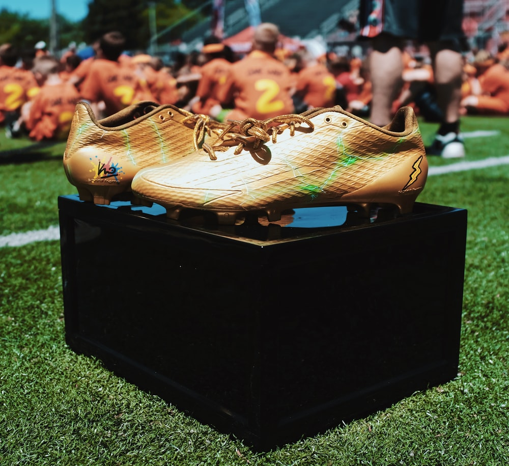 pair of brown cleats on box
