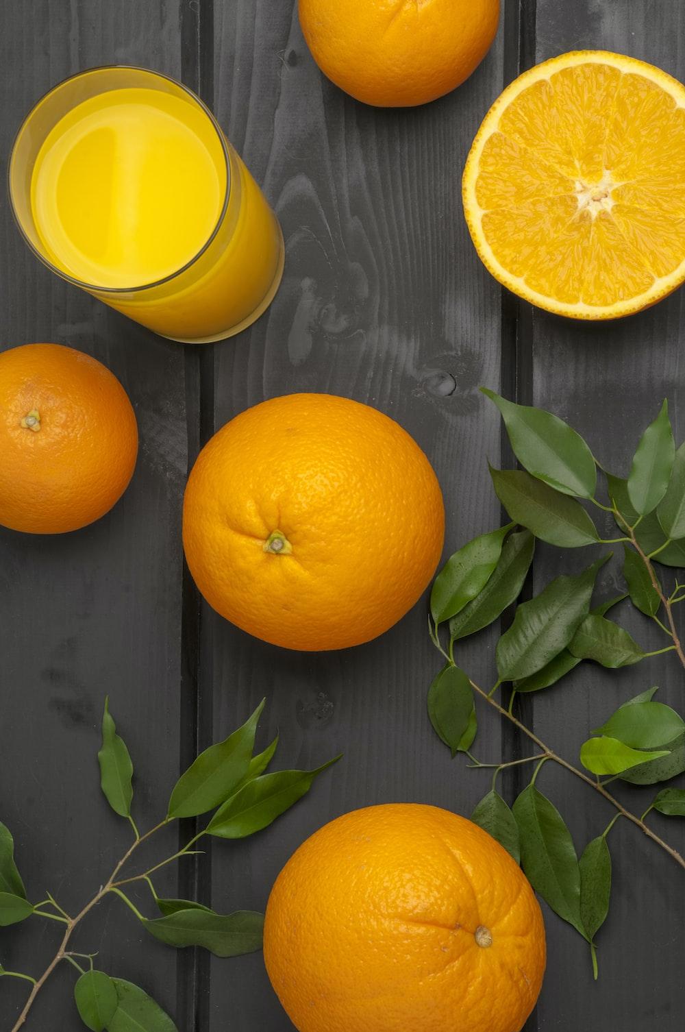orange citrus fruits with juice