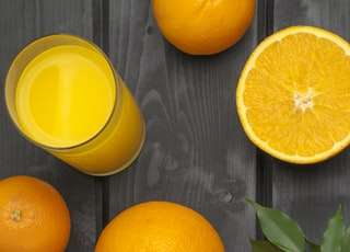 orange citrus fruits with juice