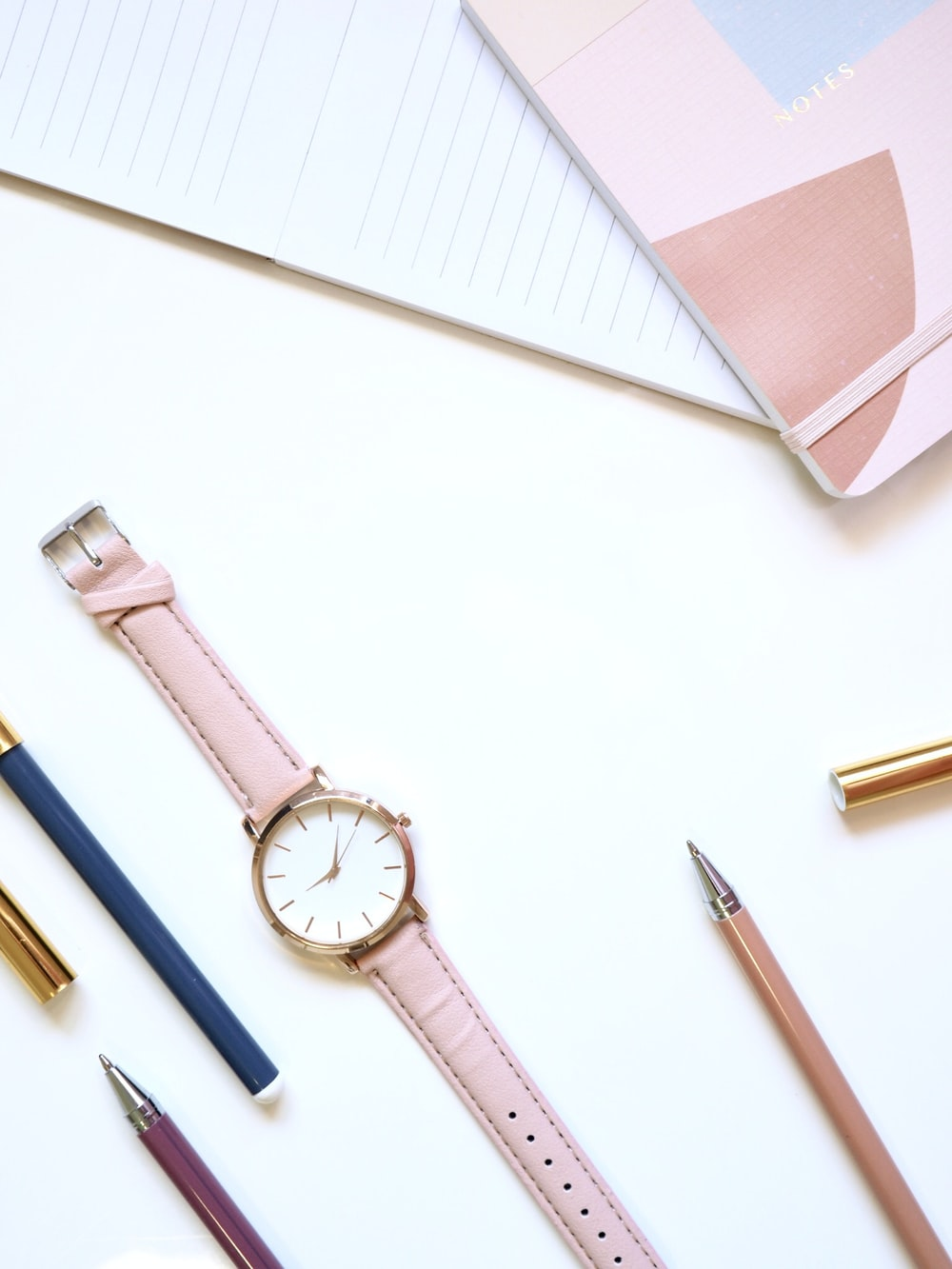 round gold-colored analog watch