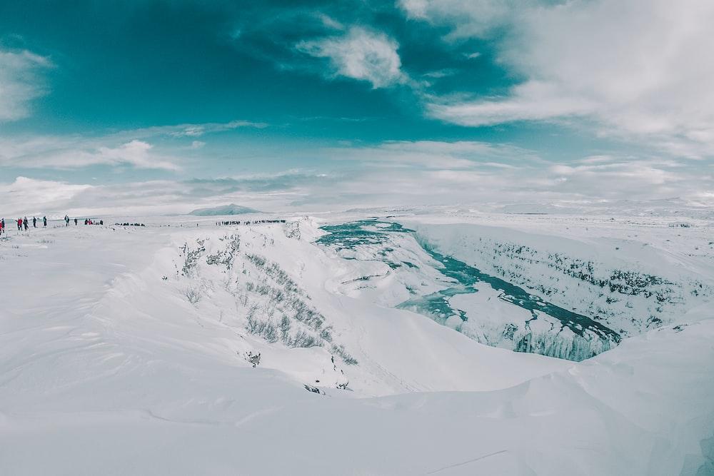bird's-eye view of snow field under blue sky