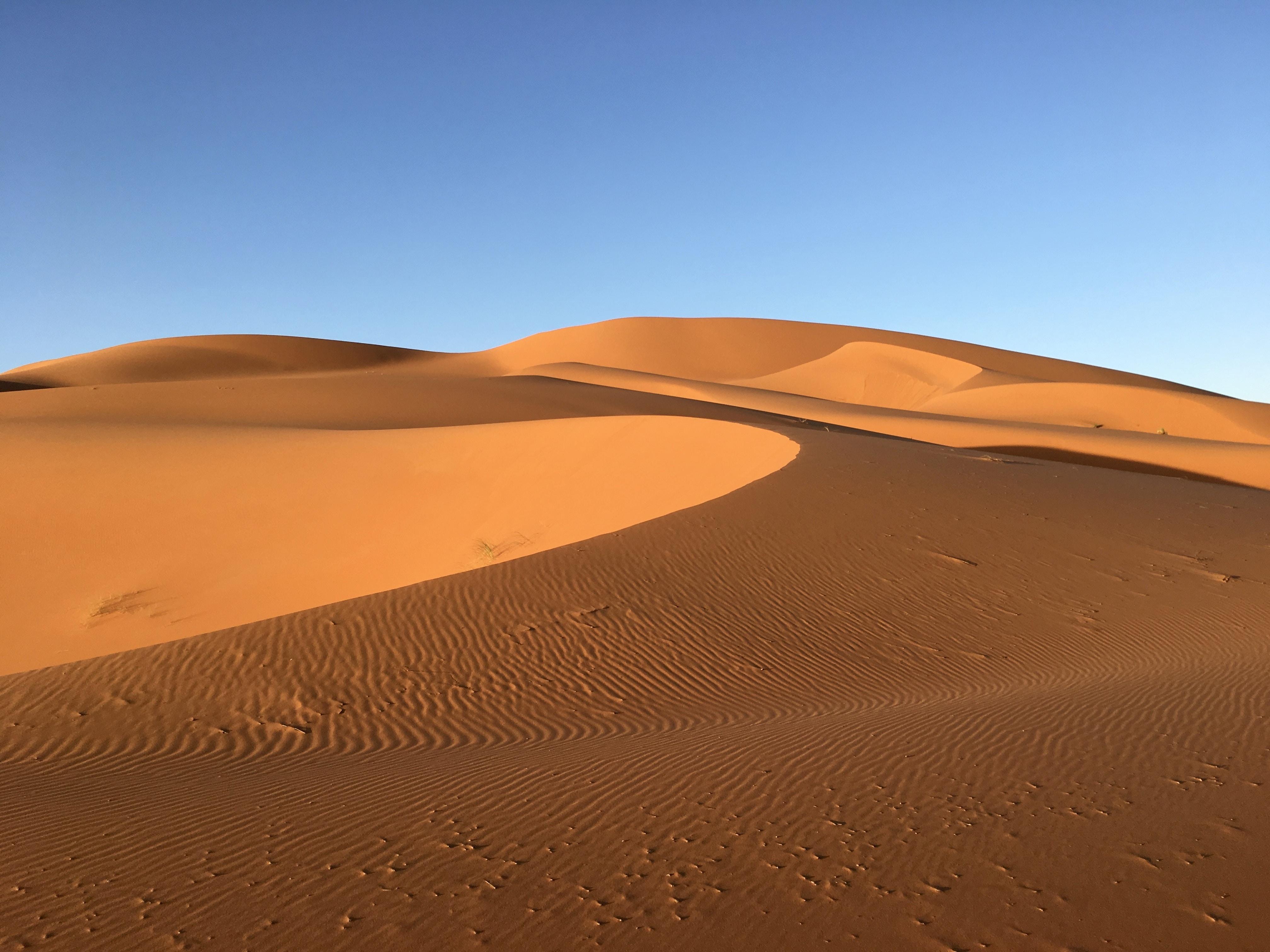 brown desert under blue sky
