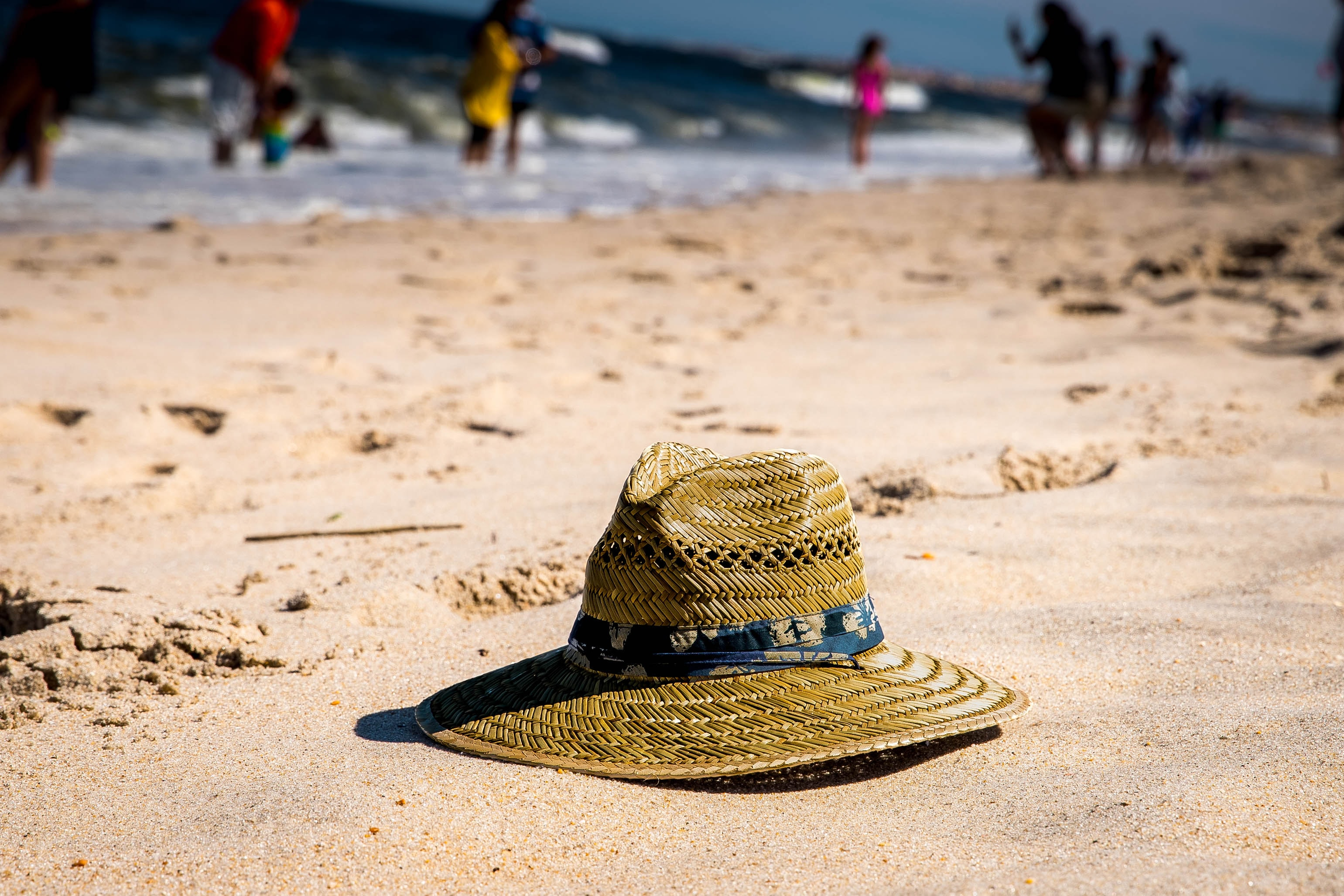 brown wicker sunhat on top of sands