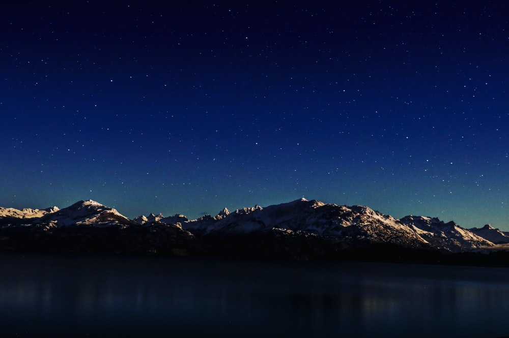 panoramic photography of mountain and sky