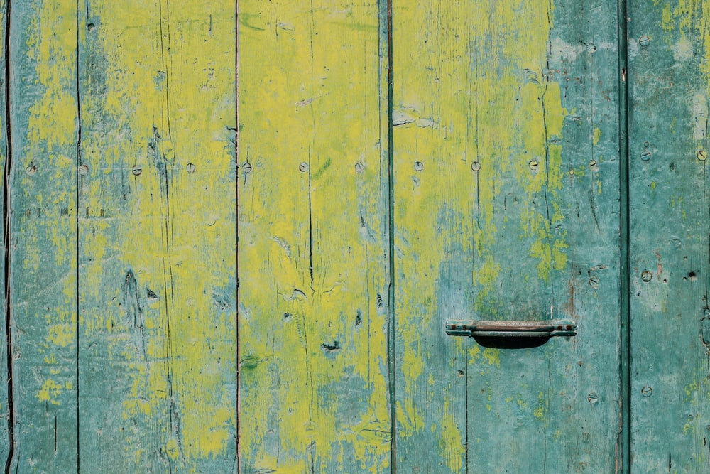 closeup photo of yellow and teal wooden board