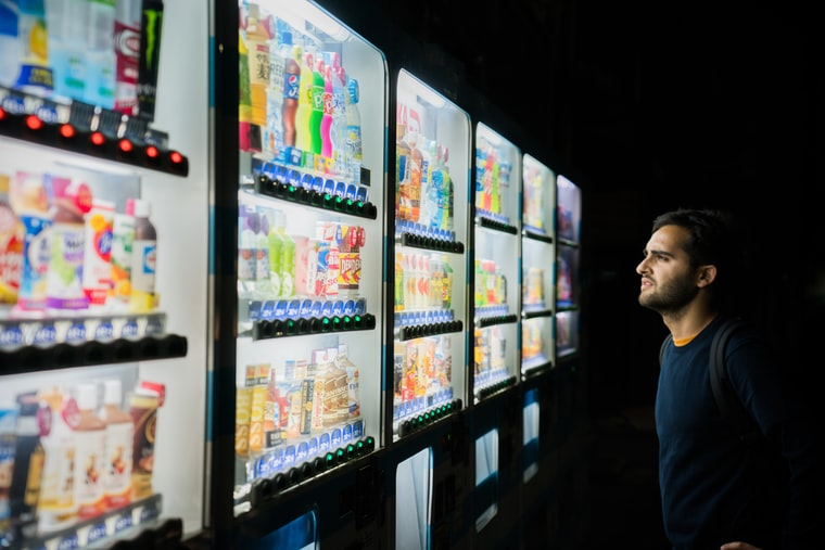 Photo of someone staring at a fridge with a lot of drinks in, by Henrik Dønnestad