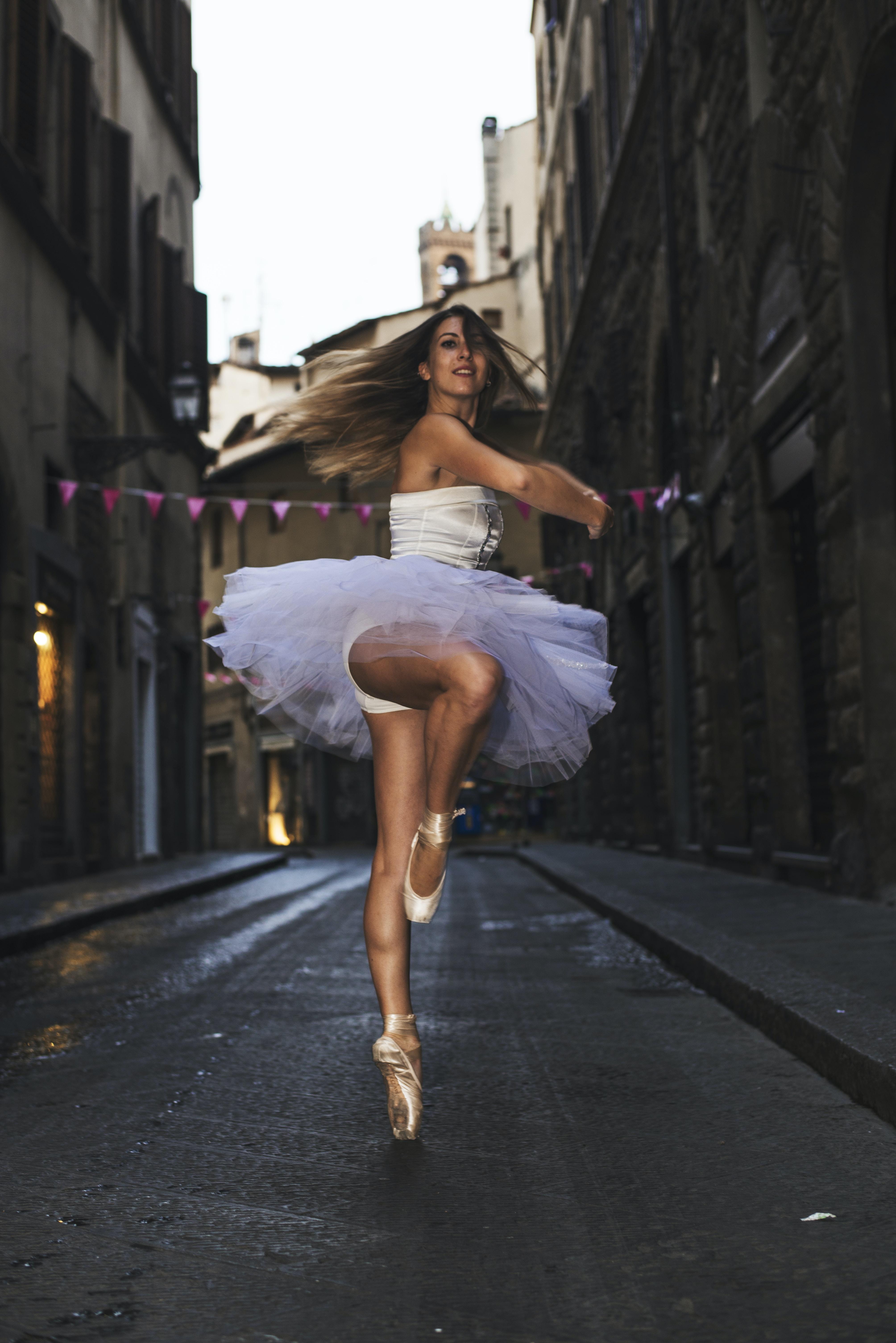 ballerina woman dancing outdoors