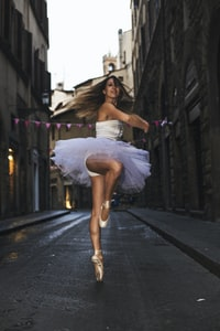 ballerina woman dancing outdoors