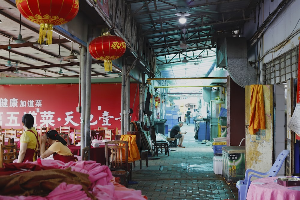 two red Chinese lanterns hanging on ceiling