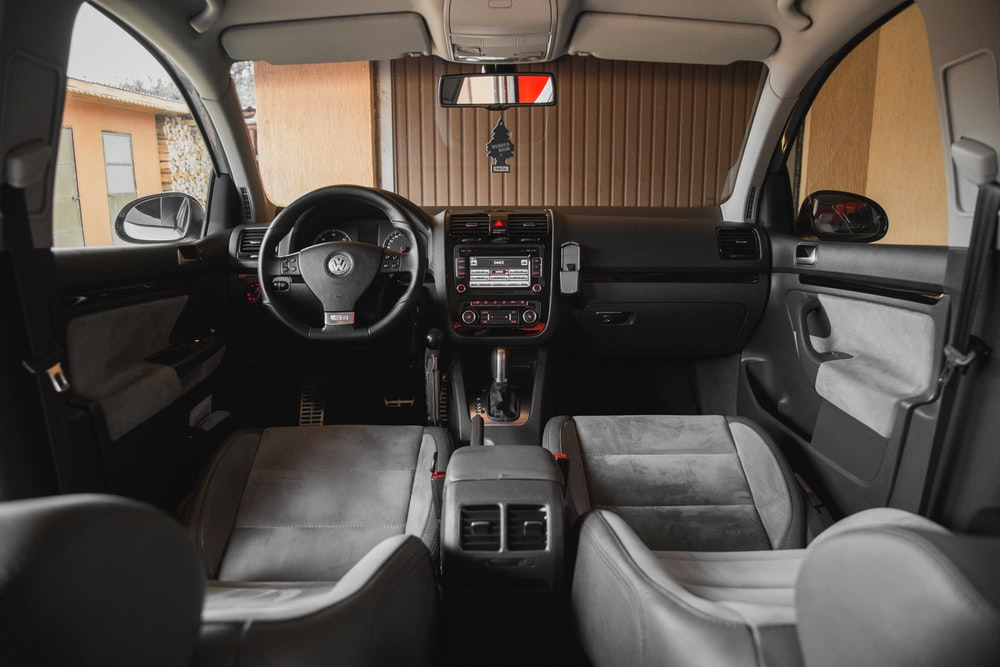 black Volkswagen vehicle interior near brown painted wall