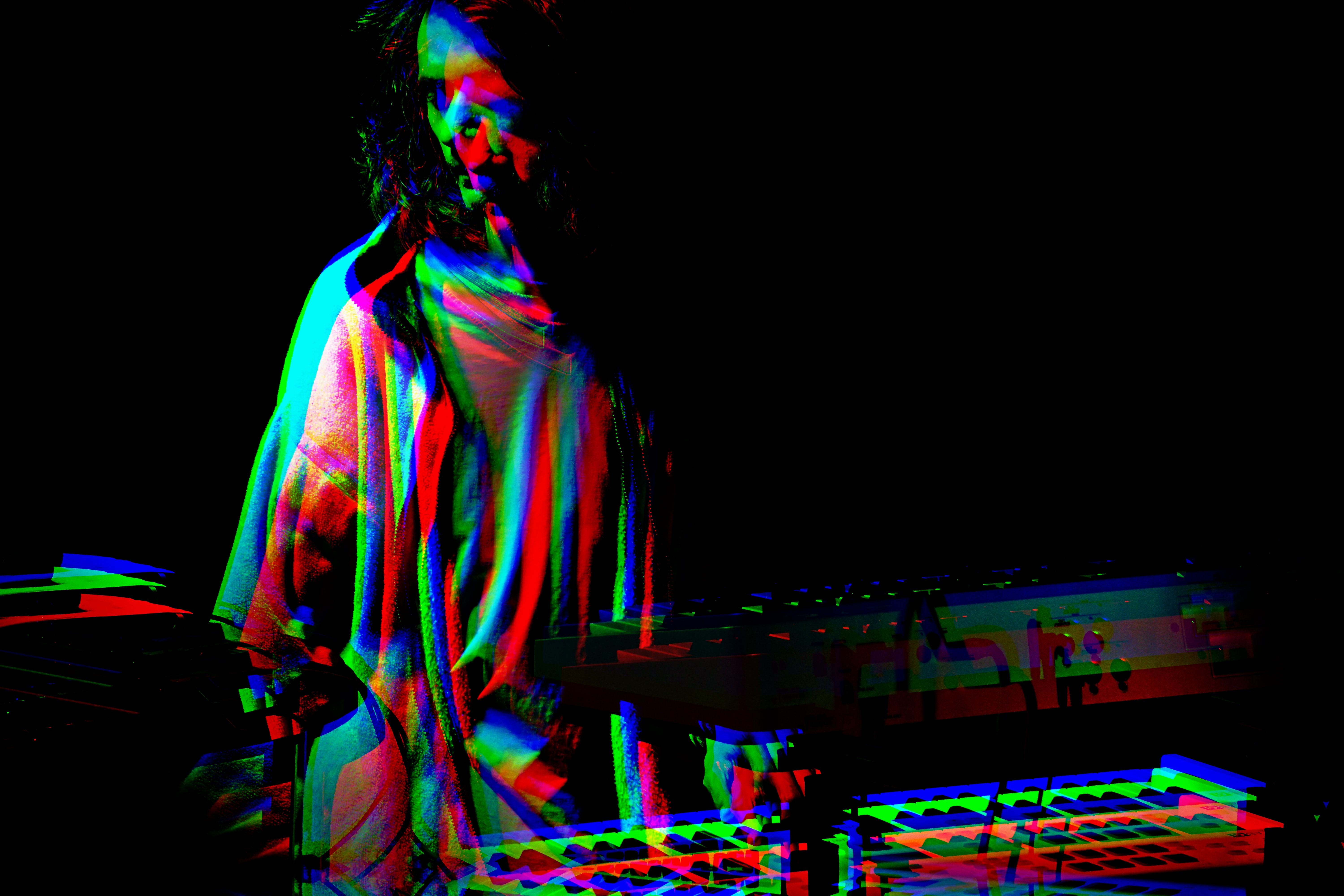 man standing in front DJ controller with photo effect
