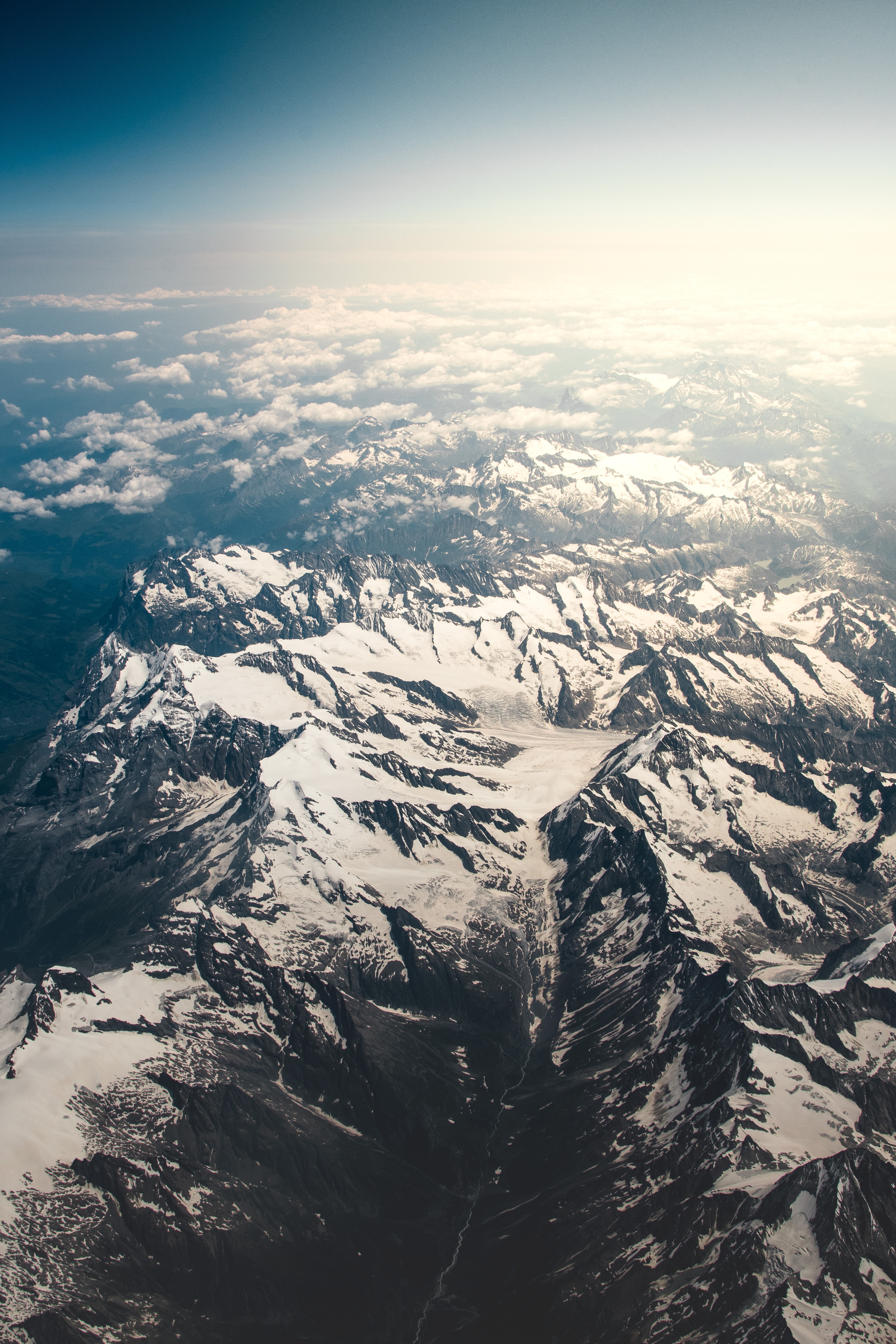 aerial view photography of mountain covered by snow at daytime