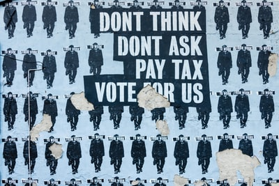 don't think do't ask pay tax vote for us text political teams background