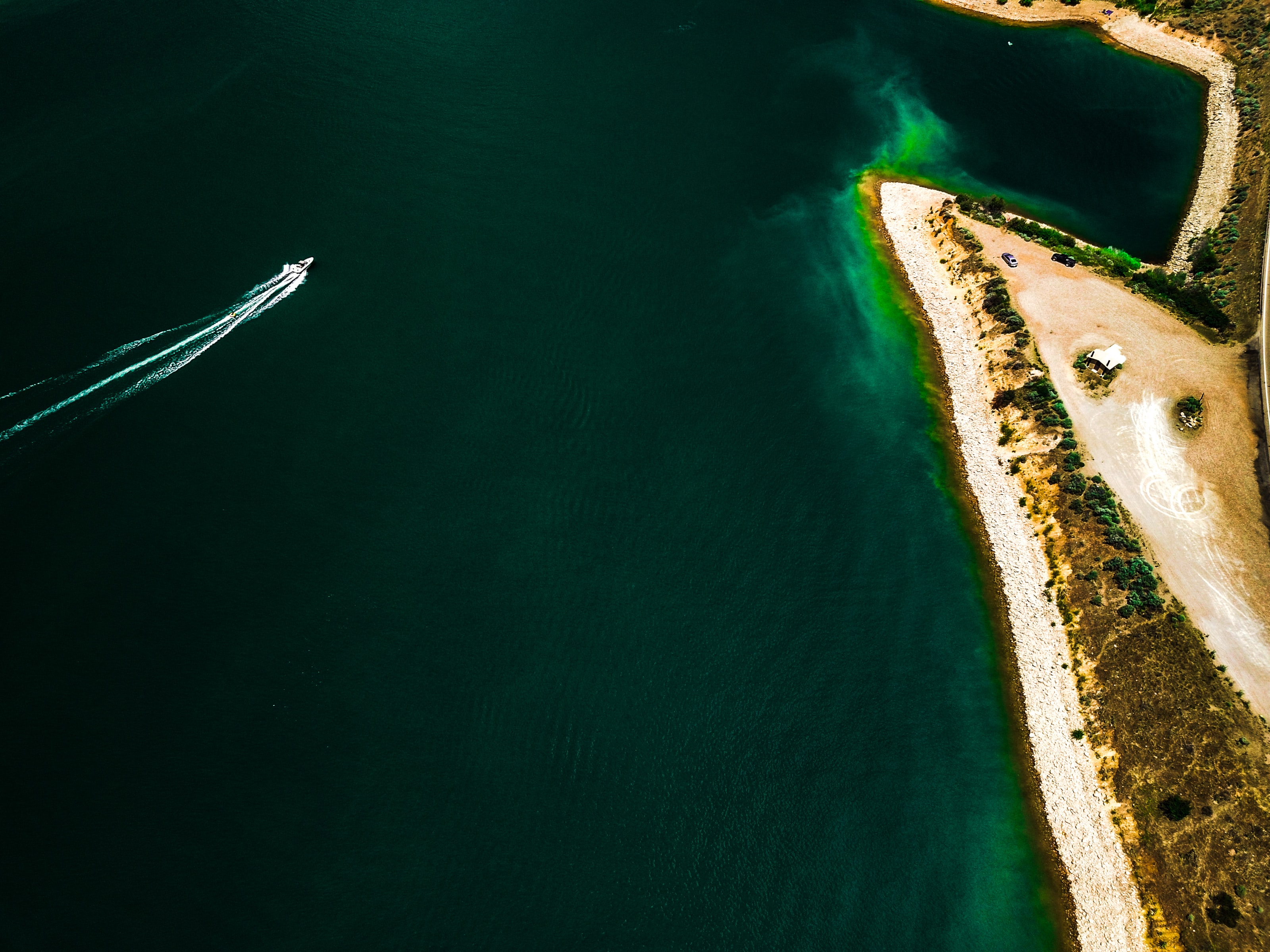 aerial photograph of powerboat about to sail on shore