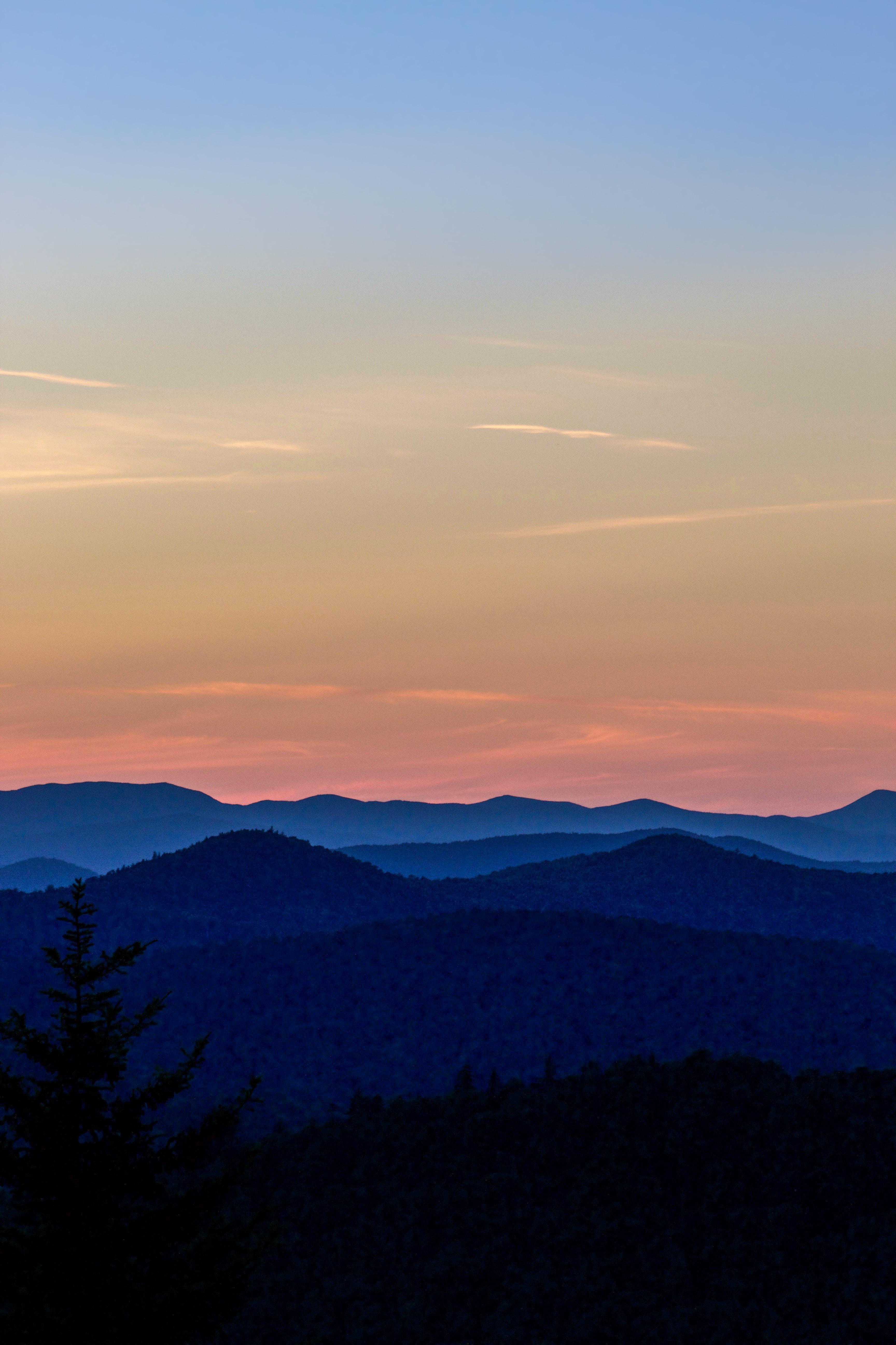 mountain hills under blue sky