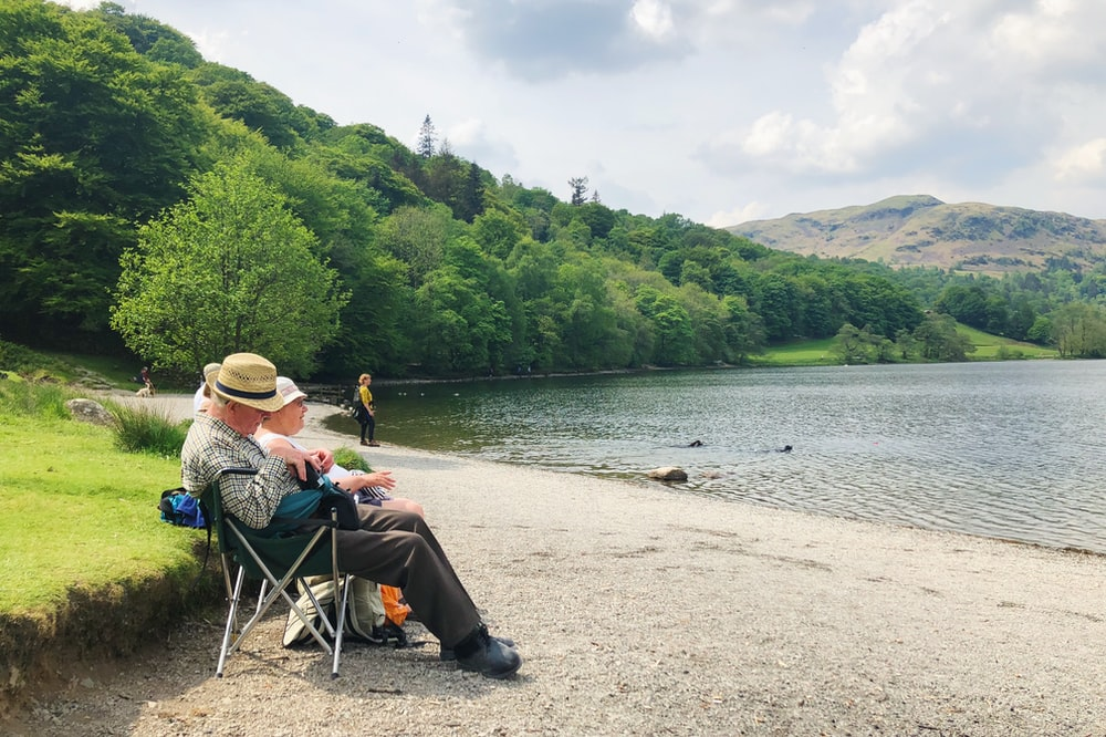 man sitting on camping chair
