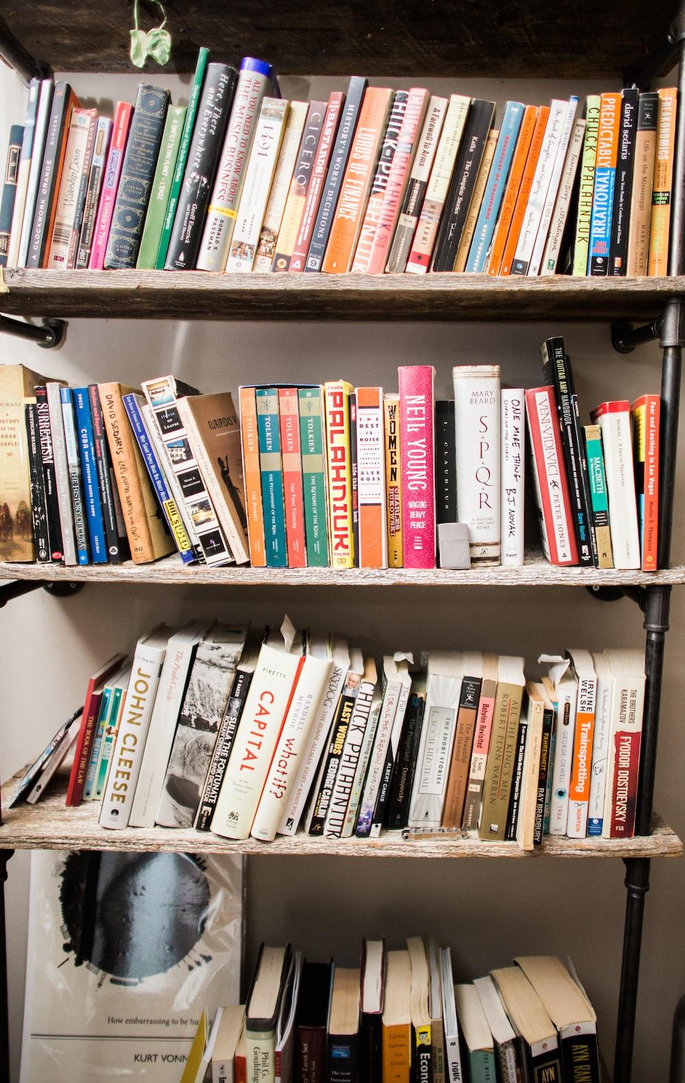 assorted book in book shelf