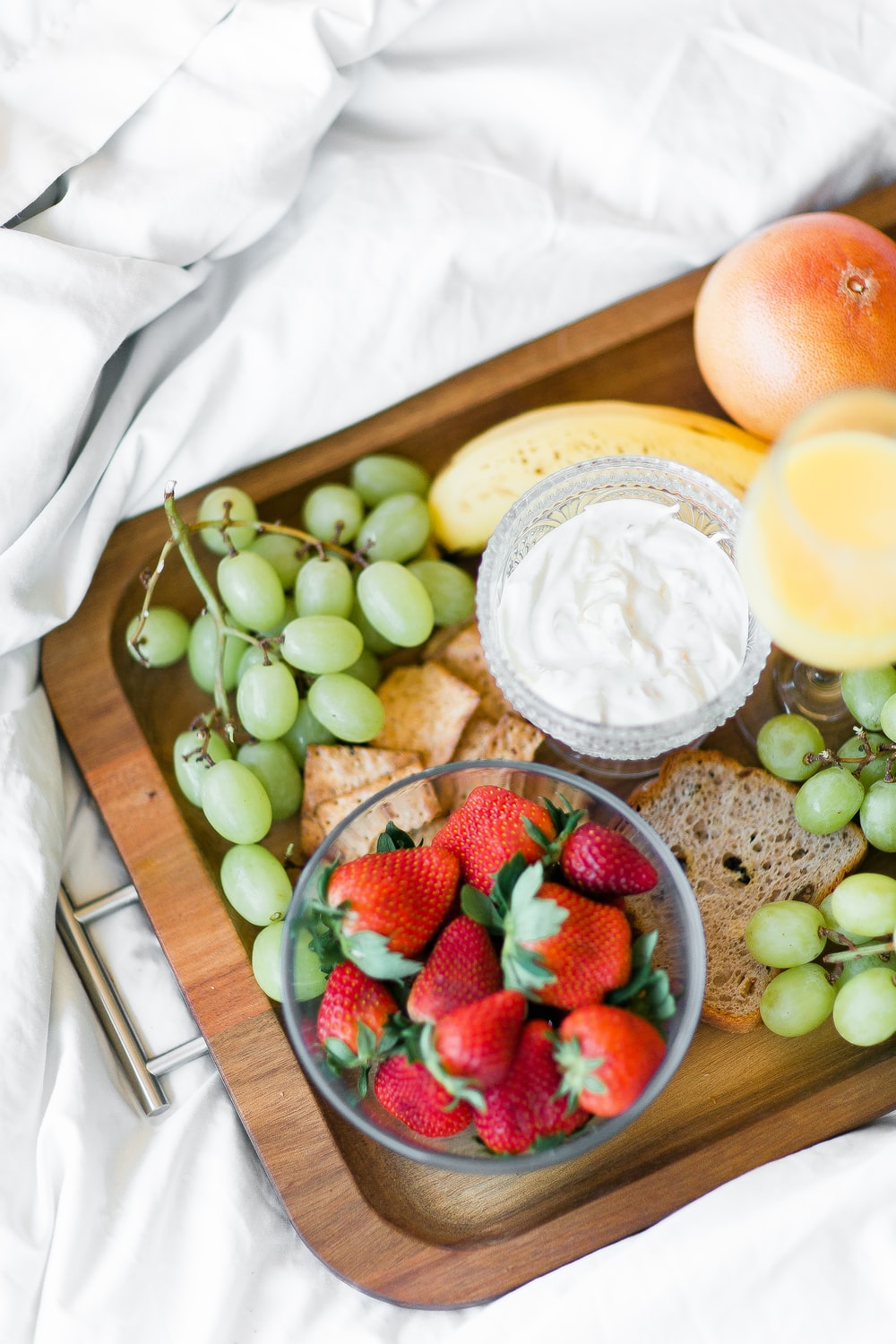 variety of fruits with dip on tray