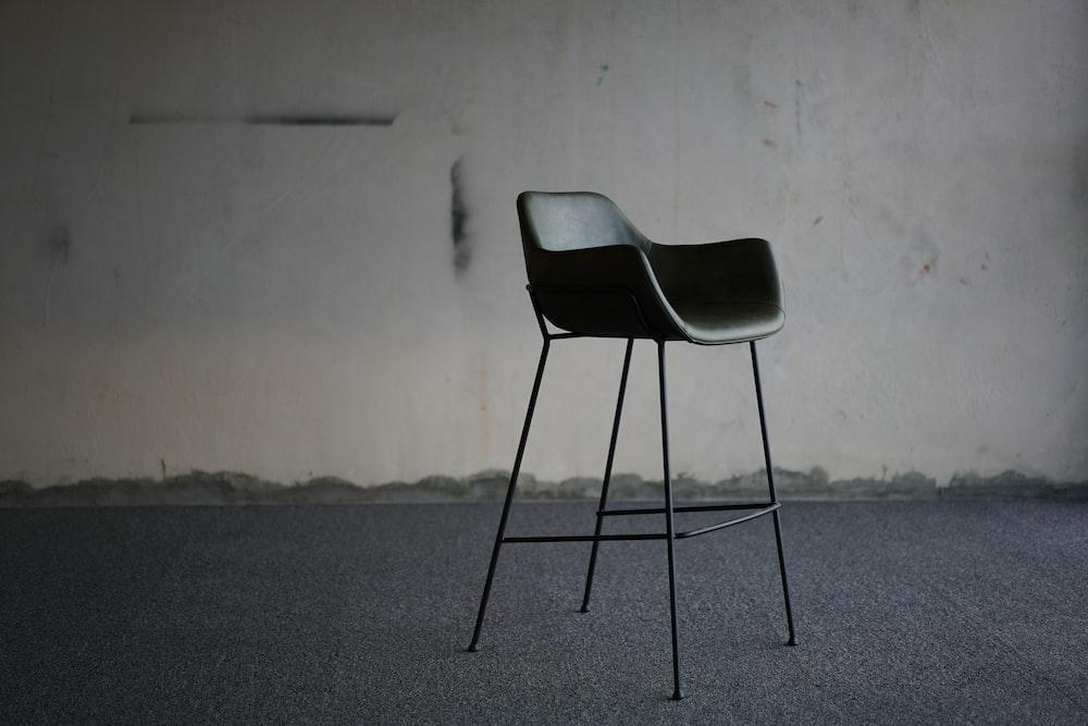 black armchair beside wall