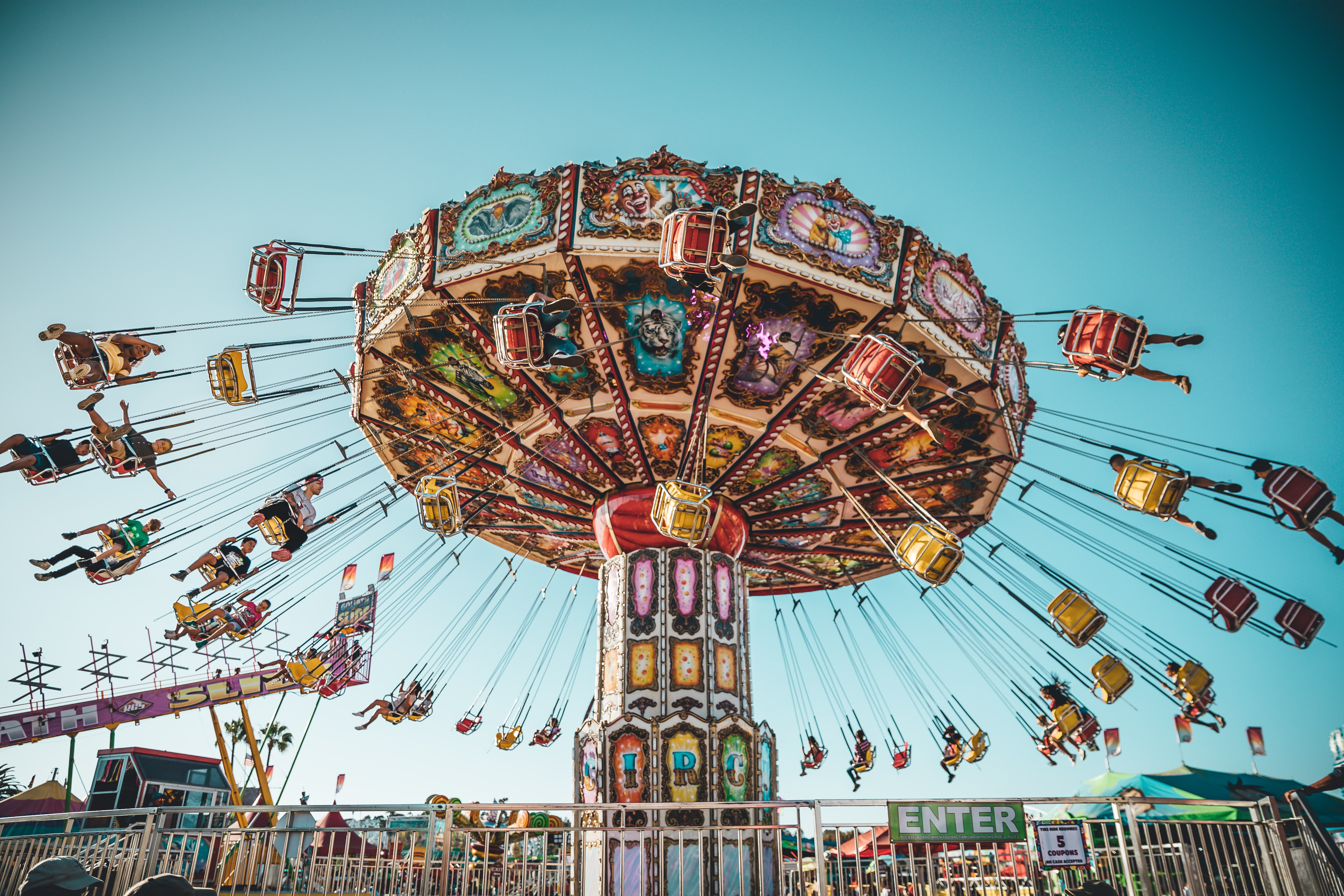 photograph of people riding swing carousel