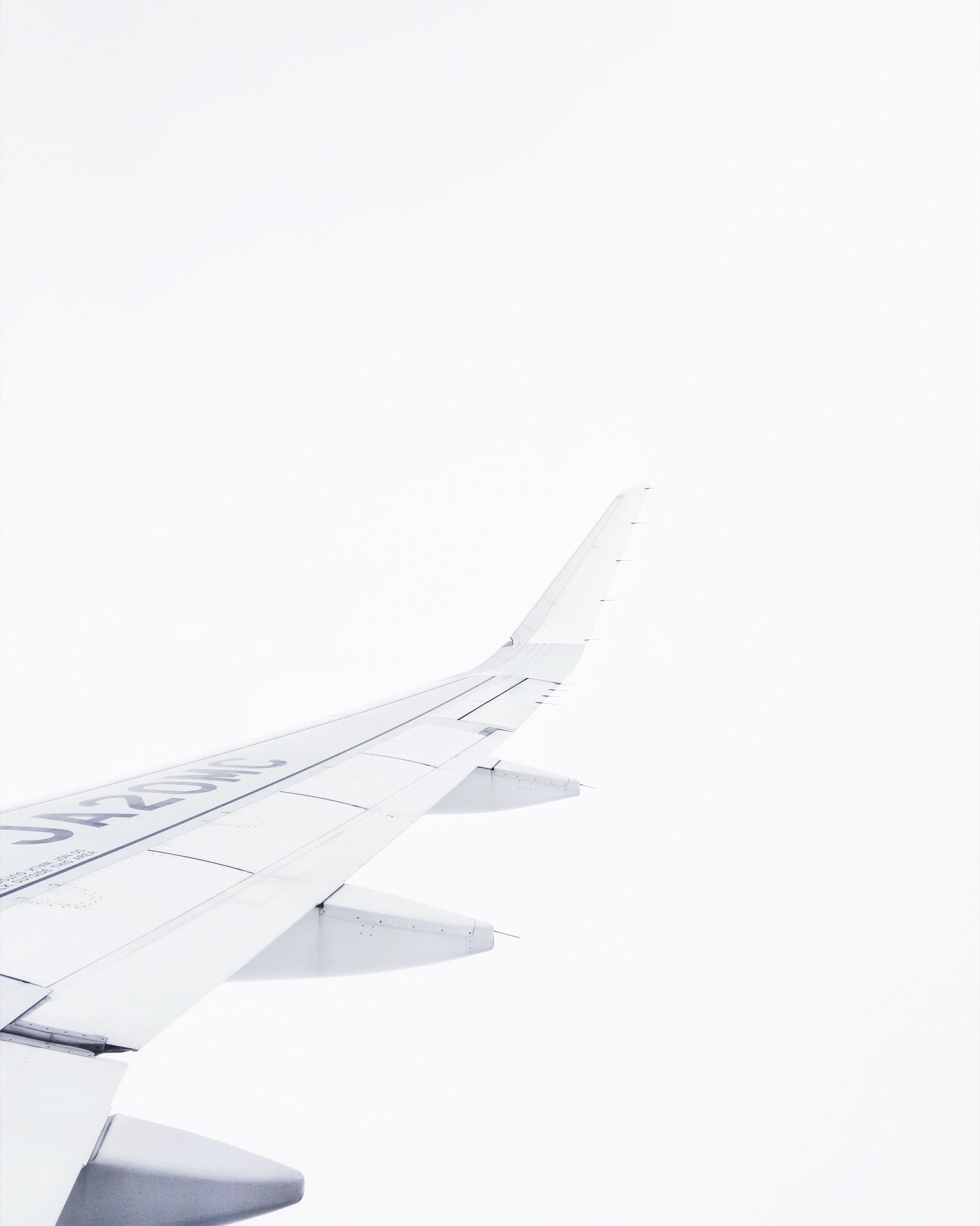 white airplane on air