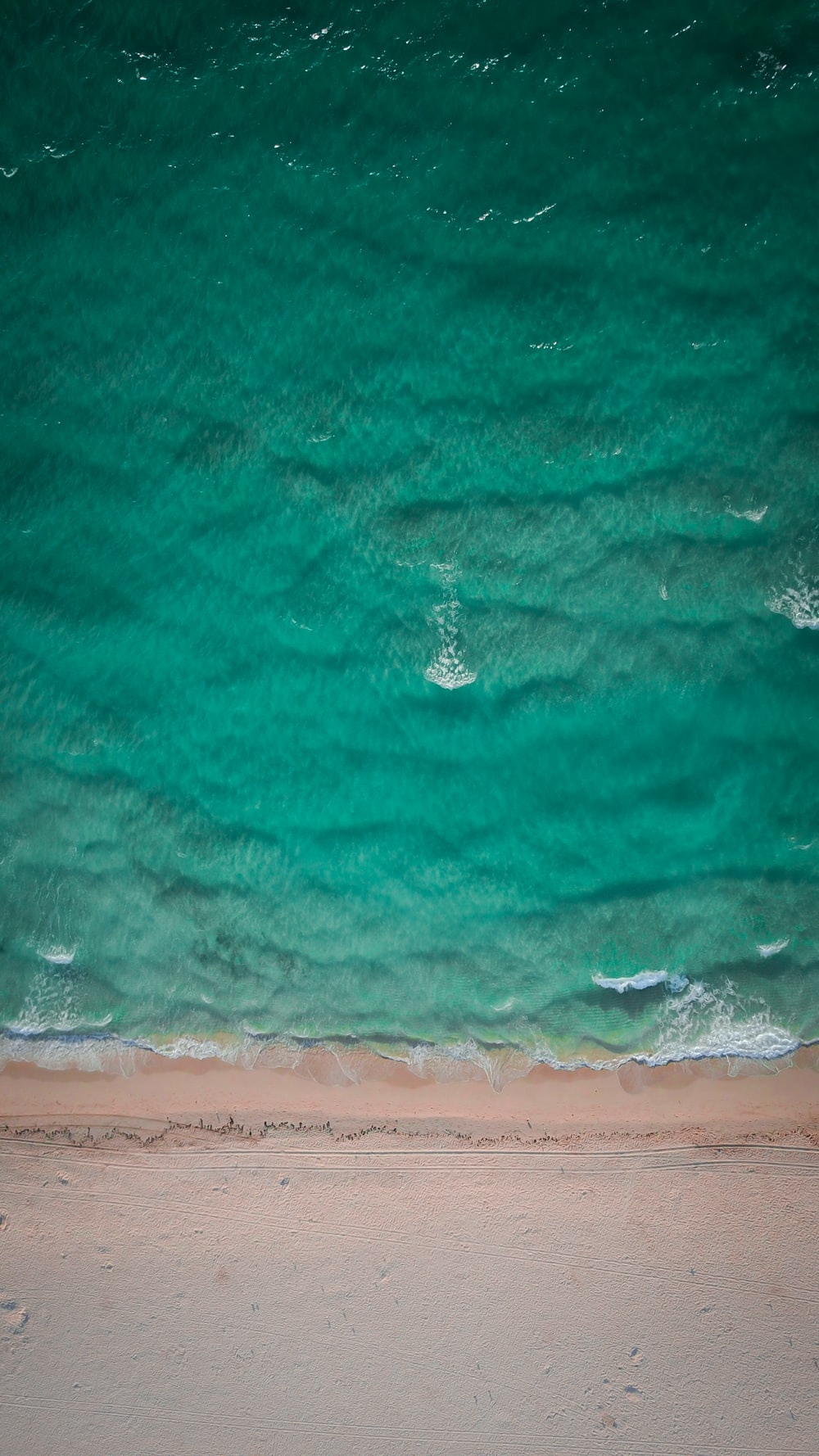 aerial photo of green body of water at daytime