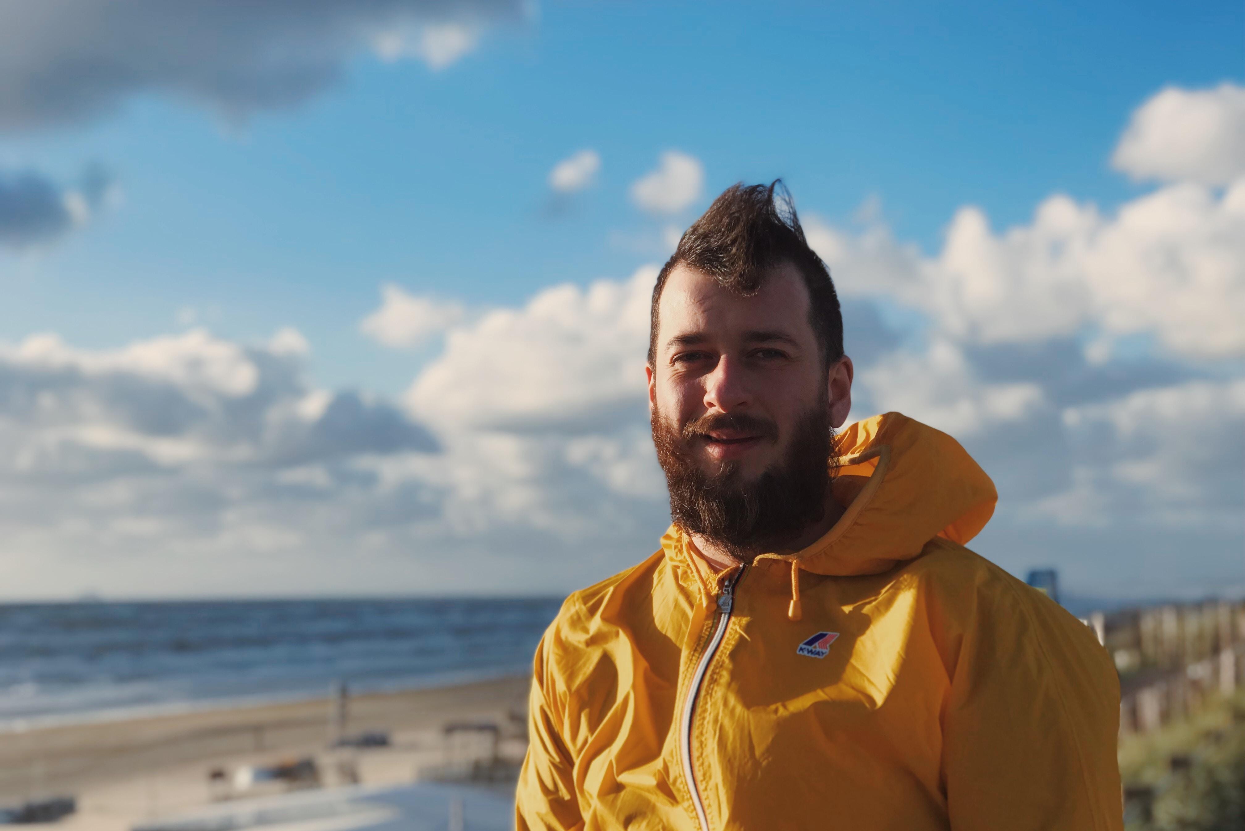 man wearing yellow zip-up jacket