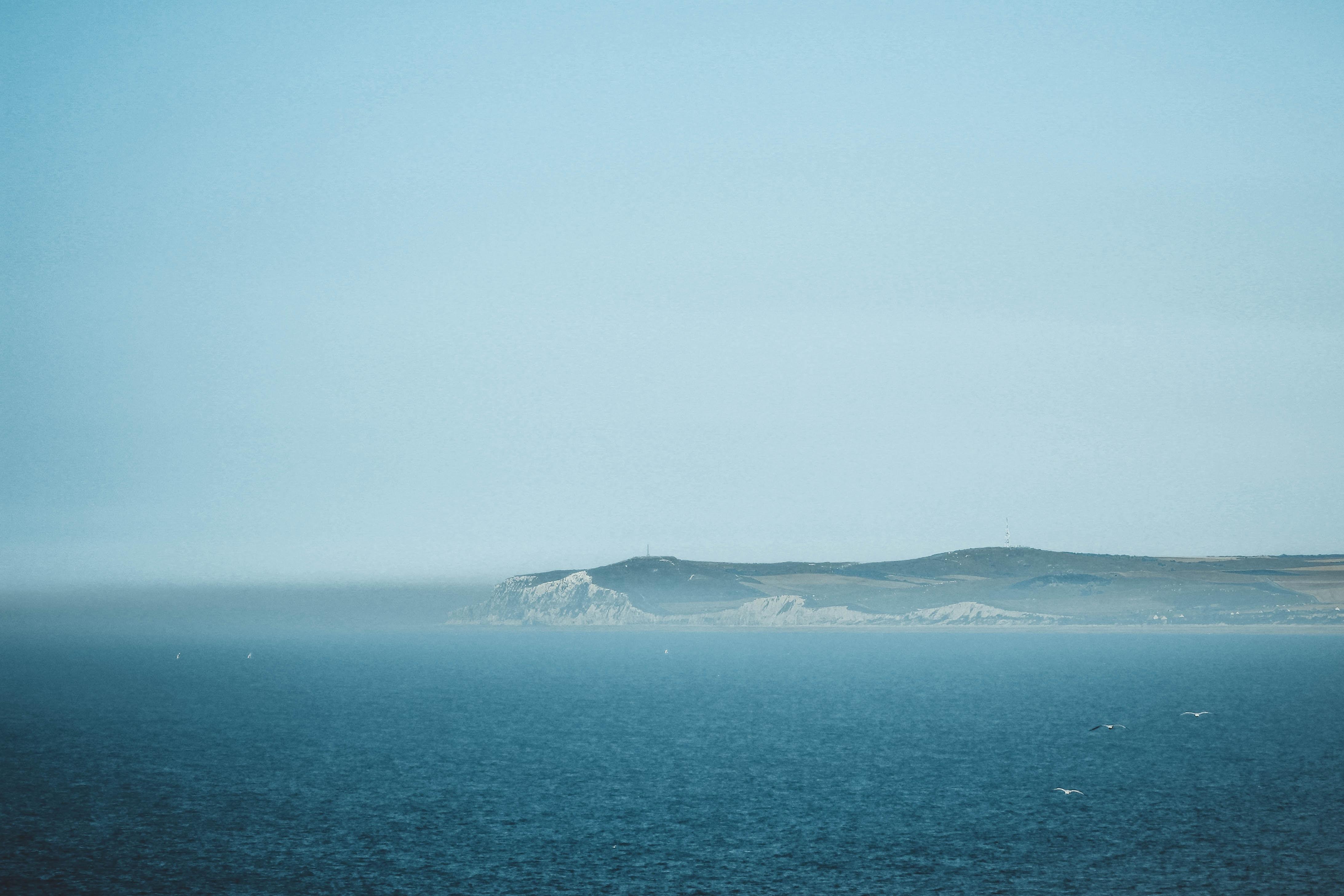 ocean under blue sky during daytime