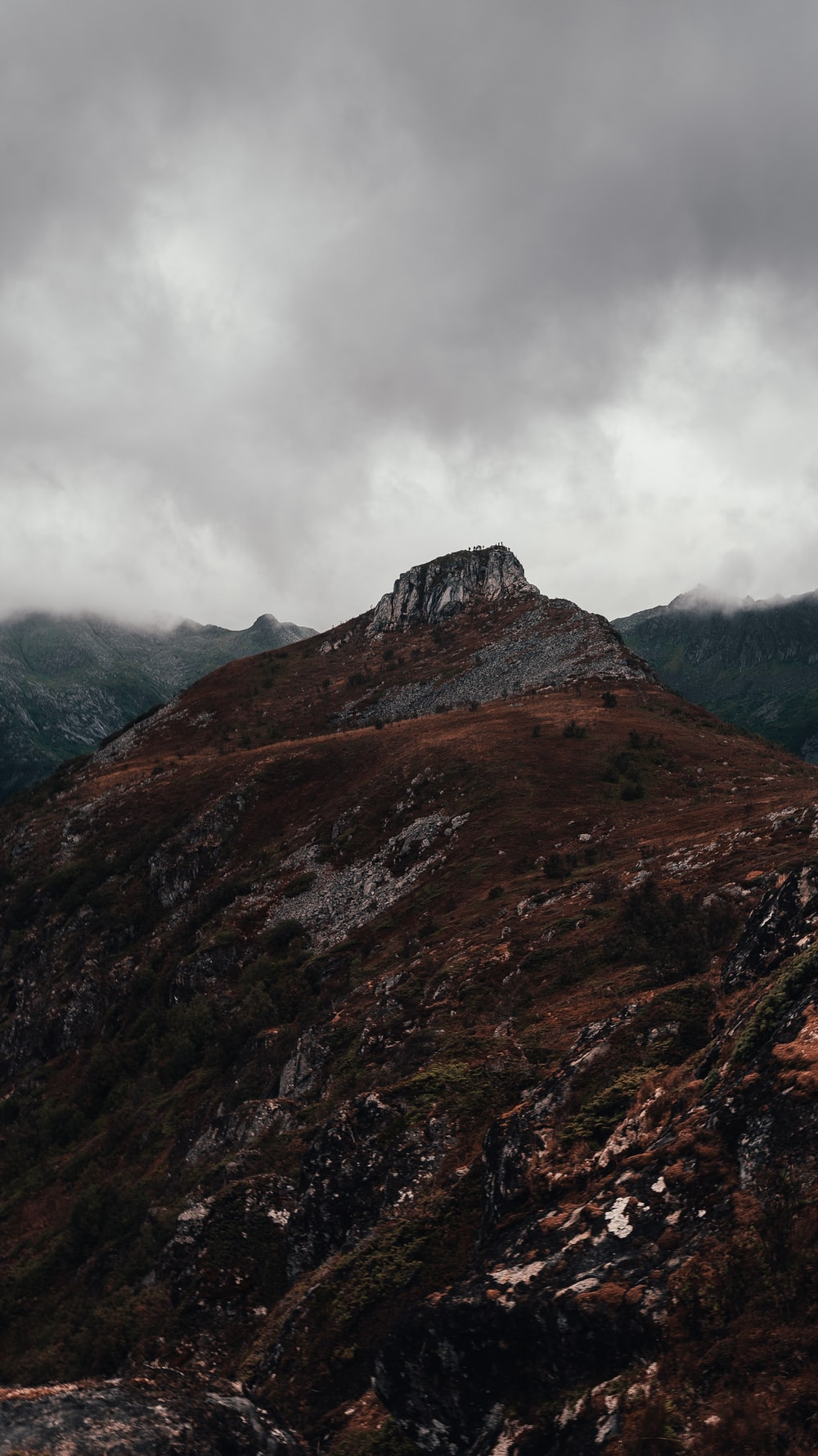 landscape photography of mountain under cloudy sky