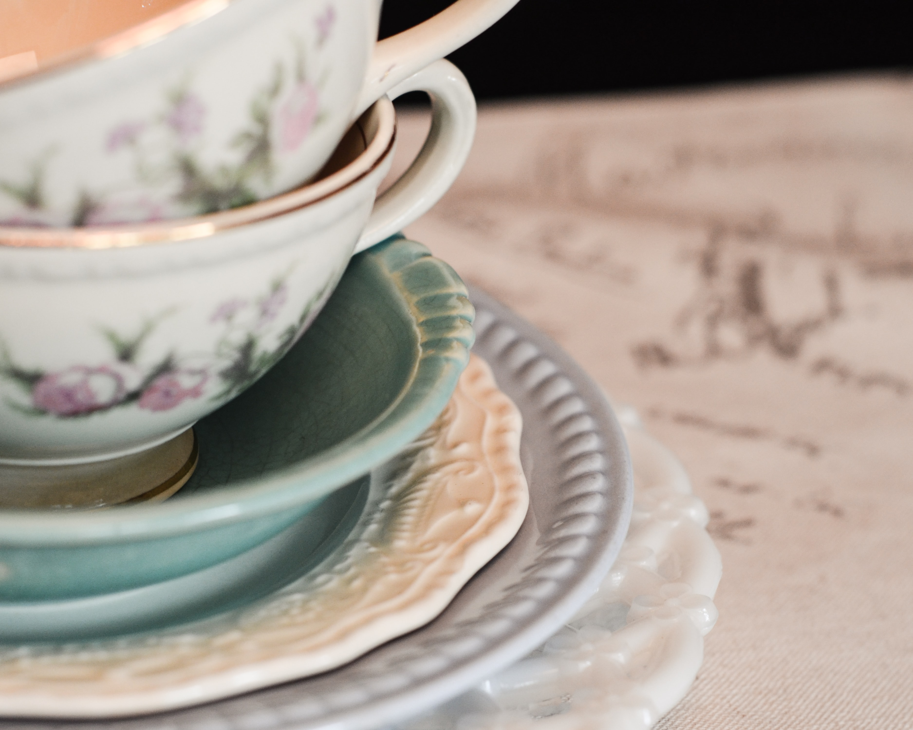 shallow focus photography of teal and white ceramic bowls and cups