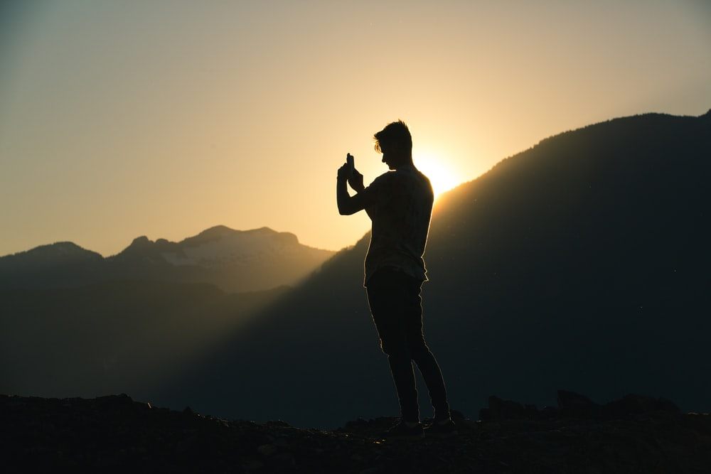 silhouette of man during golden hour