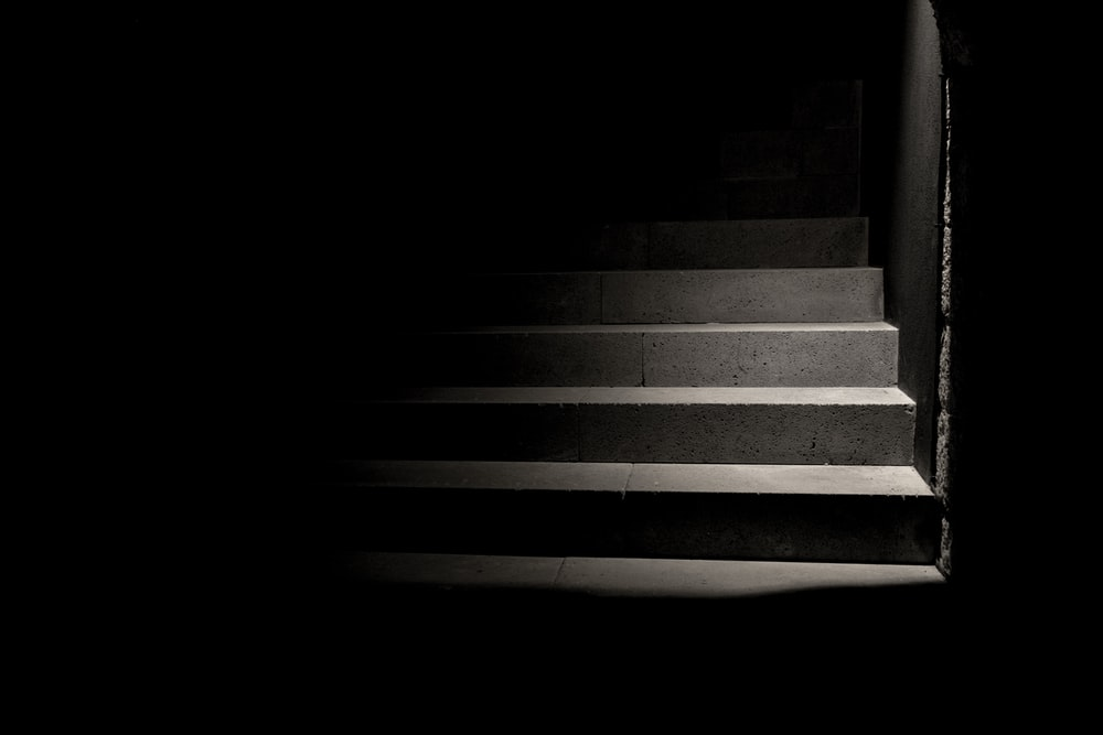 person taking photo of grey concrete stairs