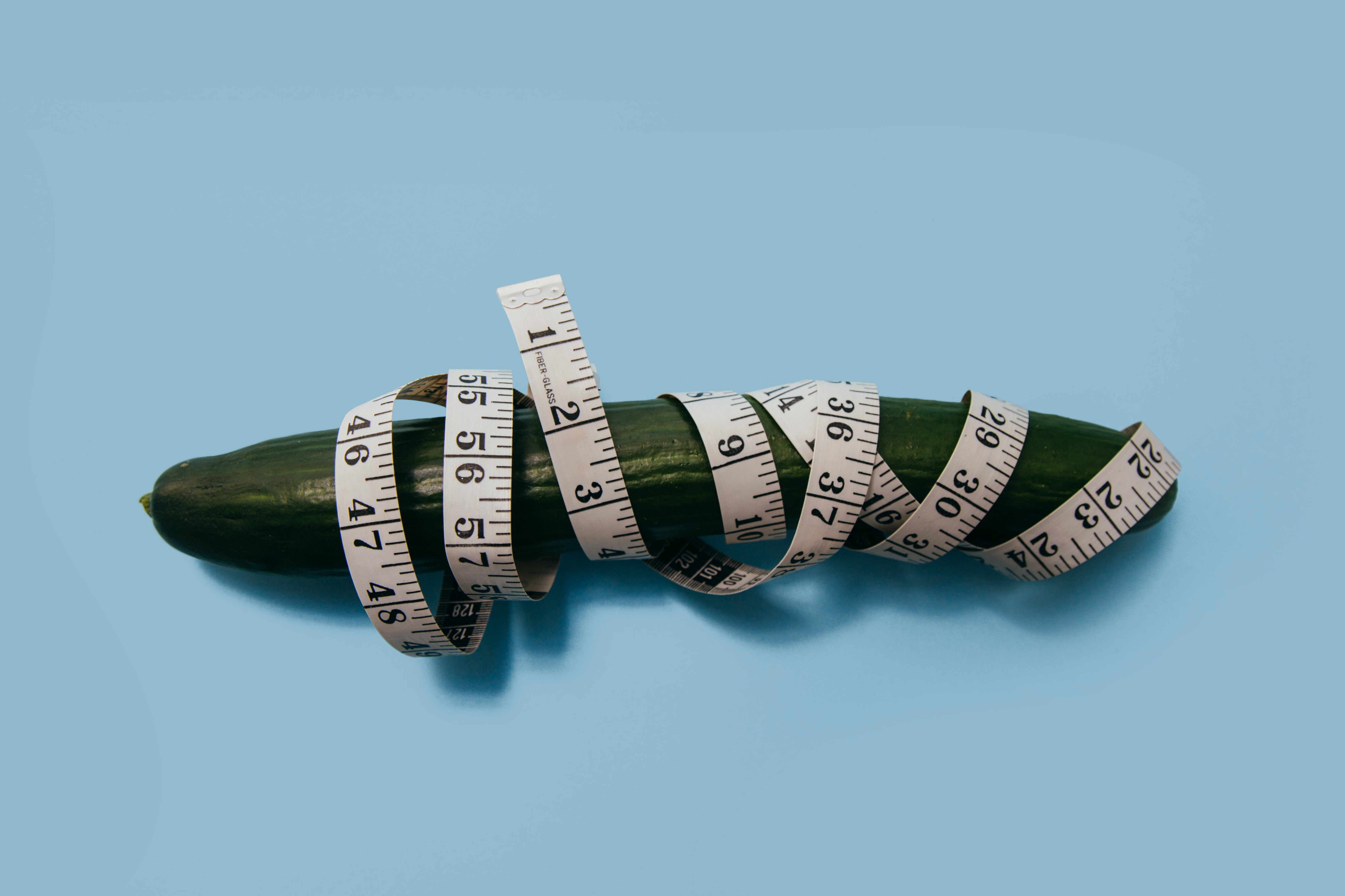 green cucumber and measuring tape