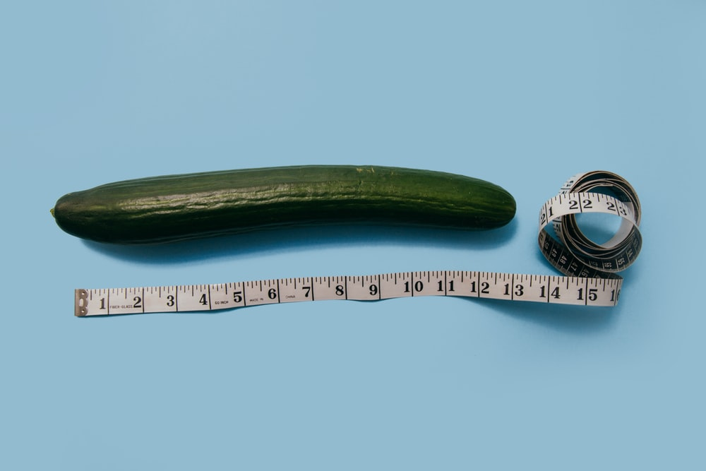 gourd and white tape measure on blue surface