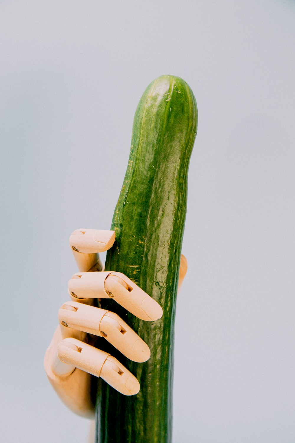 person holding cucumber