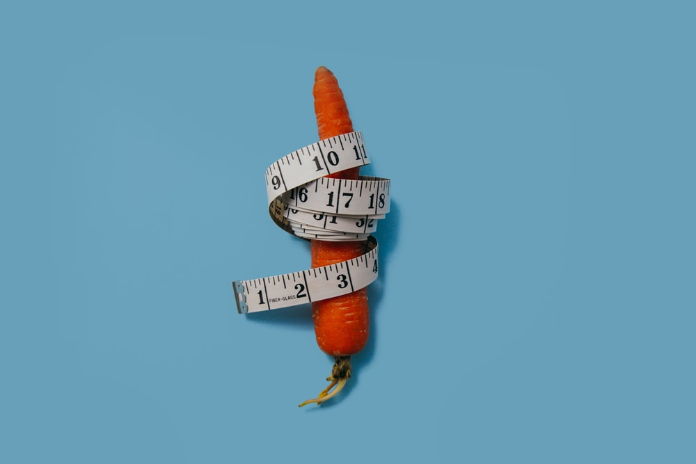 measuring tape wrapped around carrot